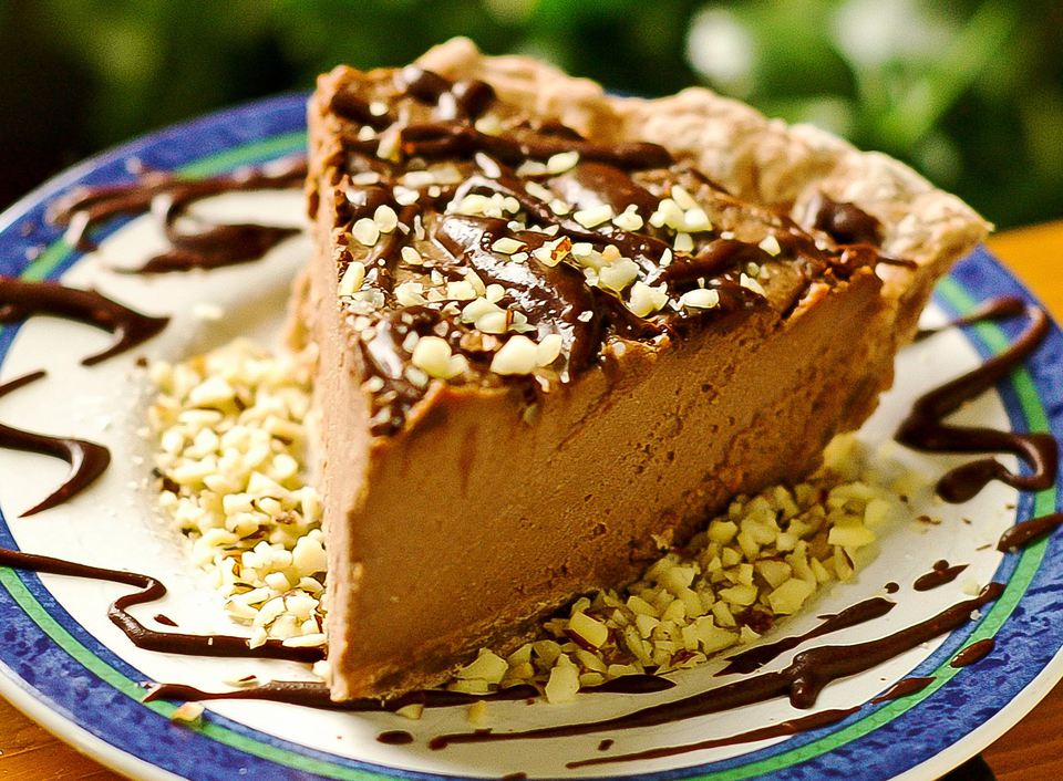 Vegan peanut butter pie with chocolate and crushed peanut topping