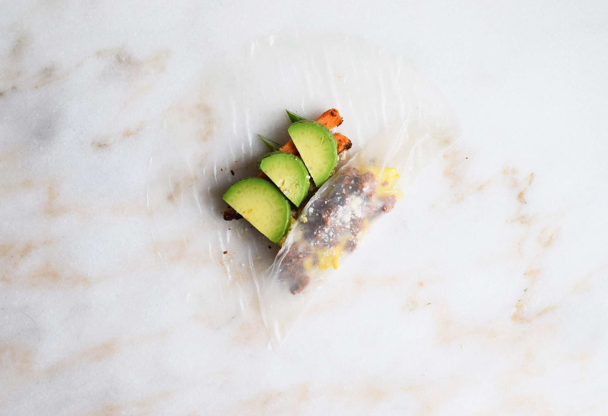 rice paper wrapper folded over chorizo and eggs