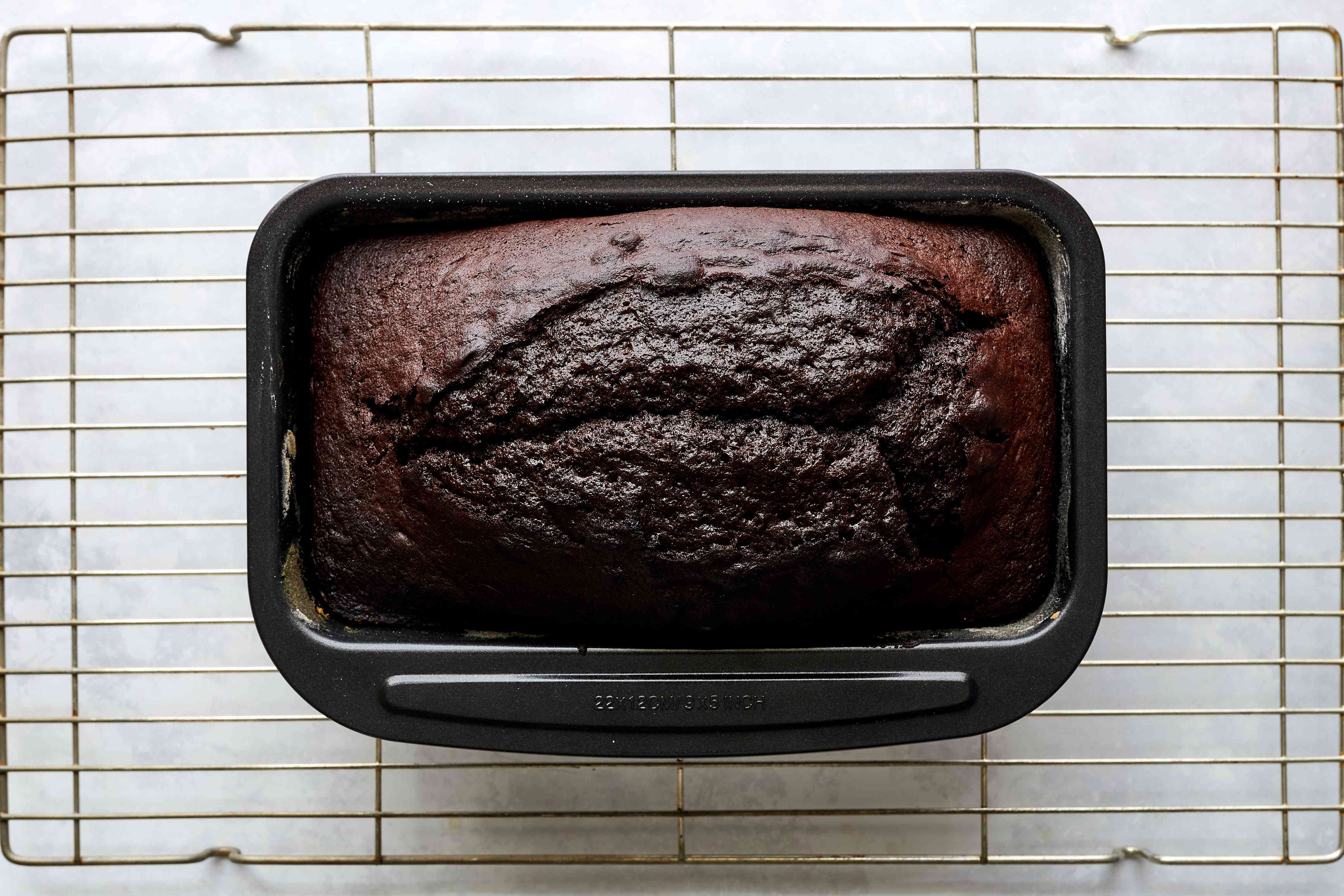 chocolate loaf cake on a cooling rack