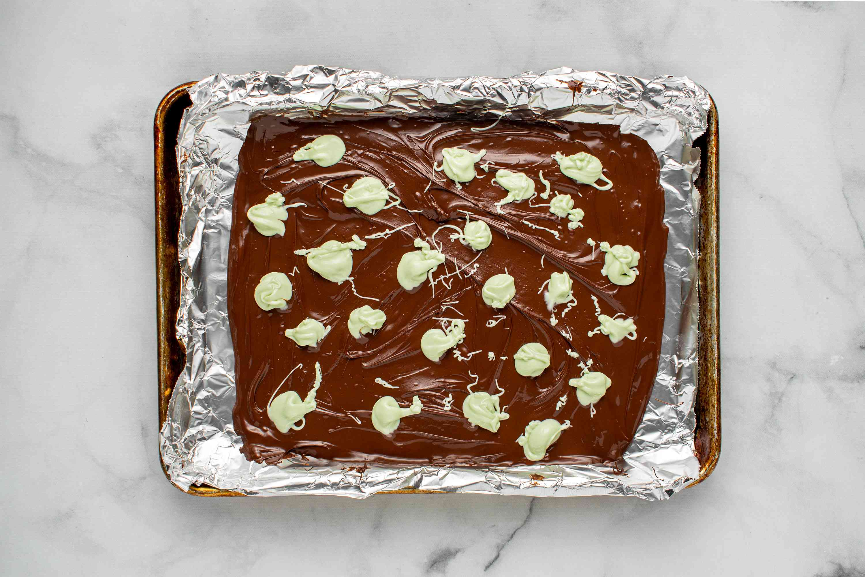 dark chocolate with white chocolate on a baking sheet