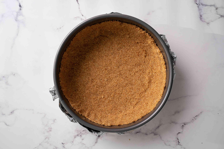 Banana cheesecake graham cracker crust in springform pan
