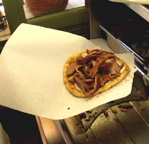 Add the meat to the gyro sandwich