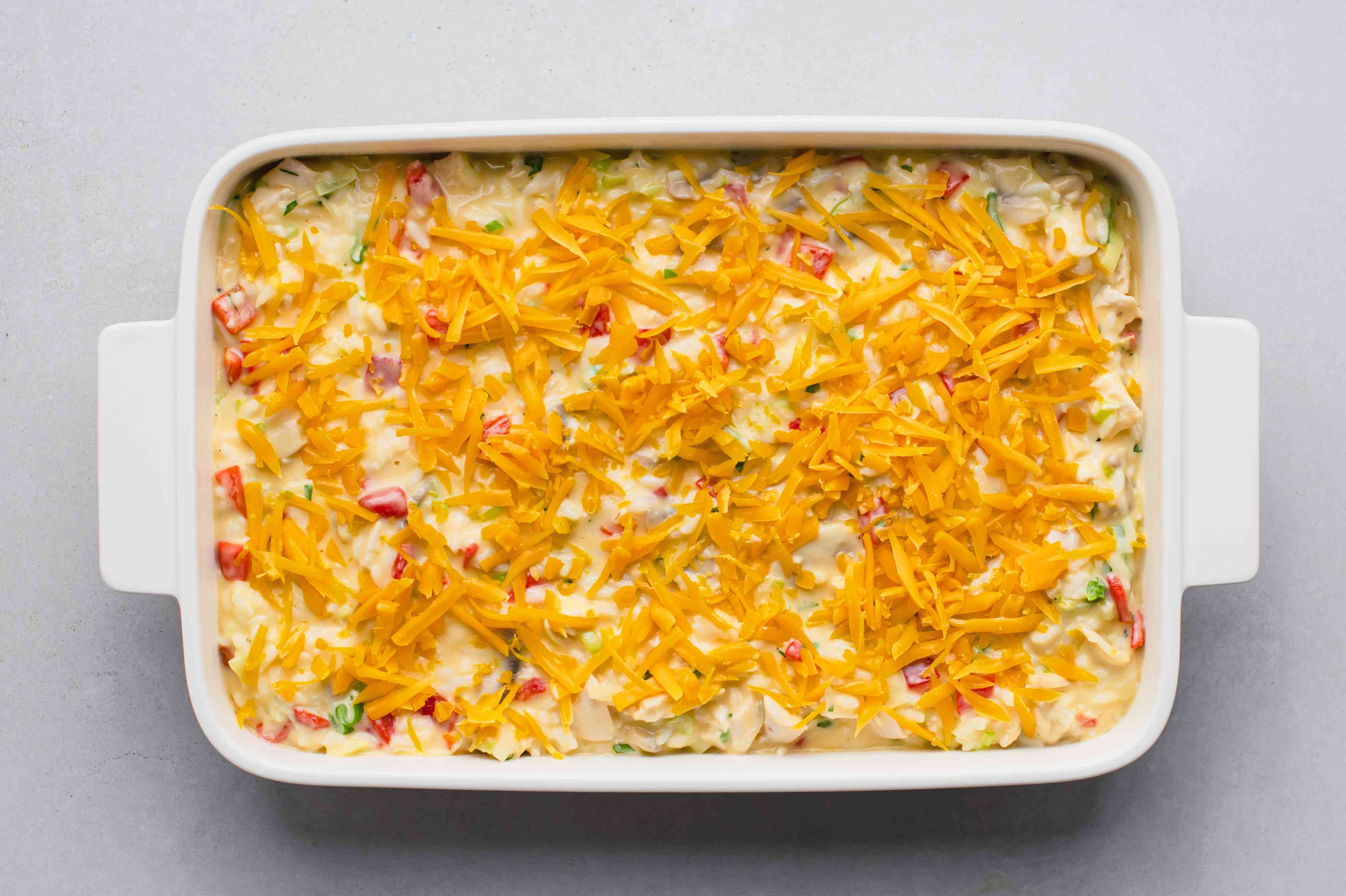 chicken and rice mixture poured into the casserole dish and topped with cheese