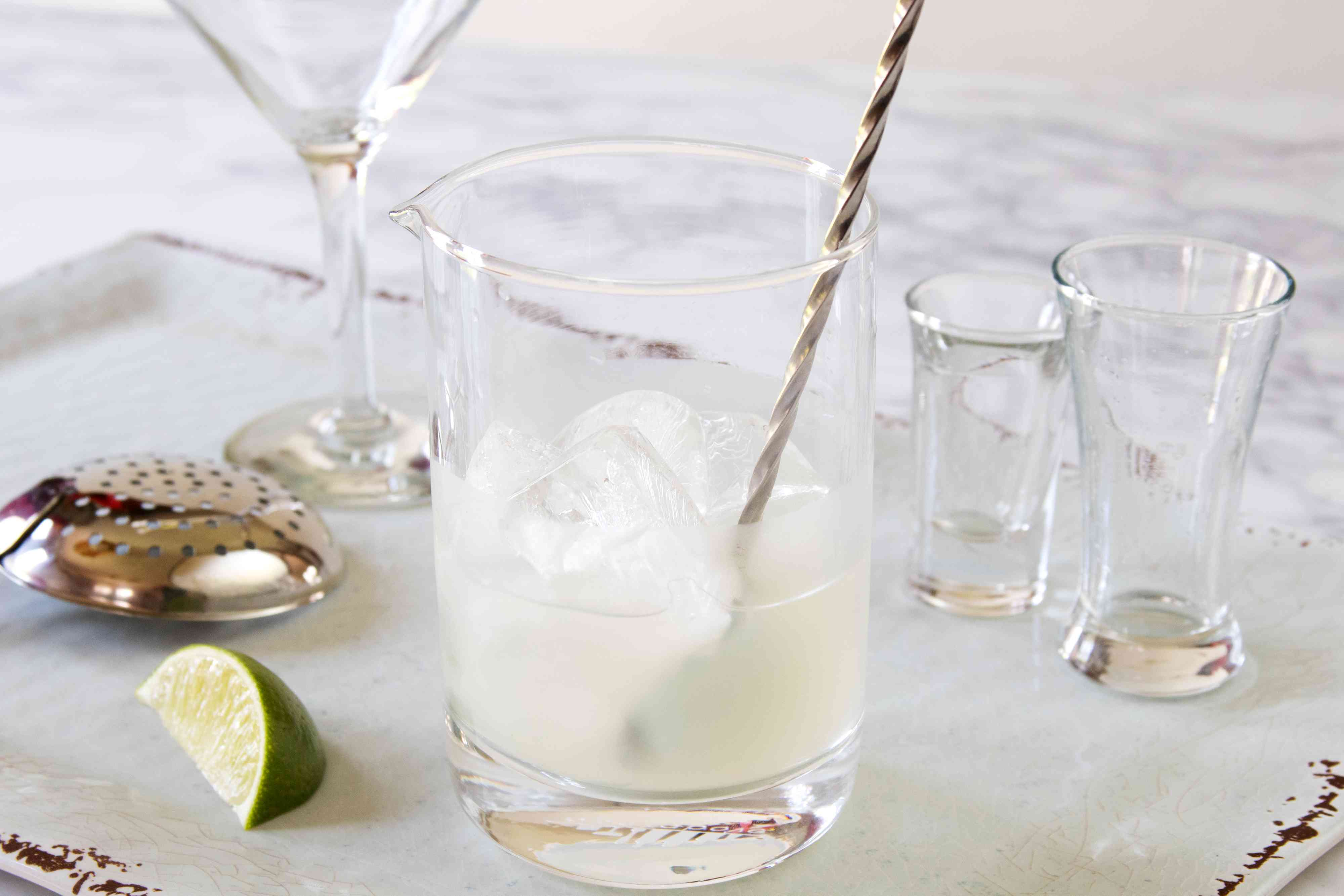 Mixing a classic gimlet cocktail