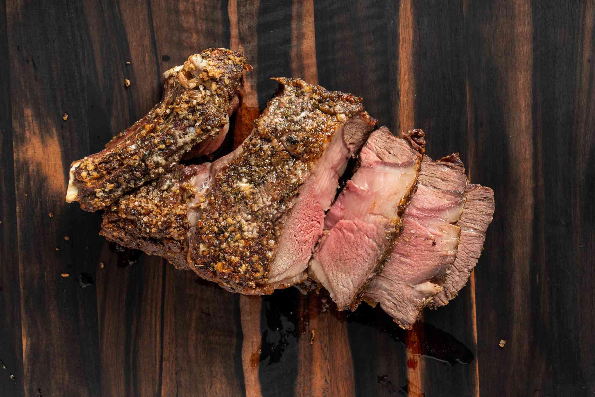 prime rib sliced on a wood board