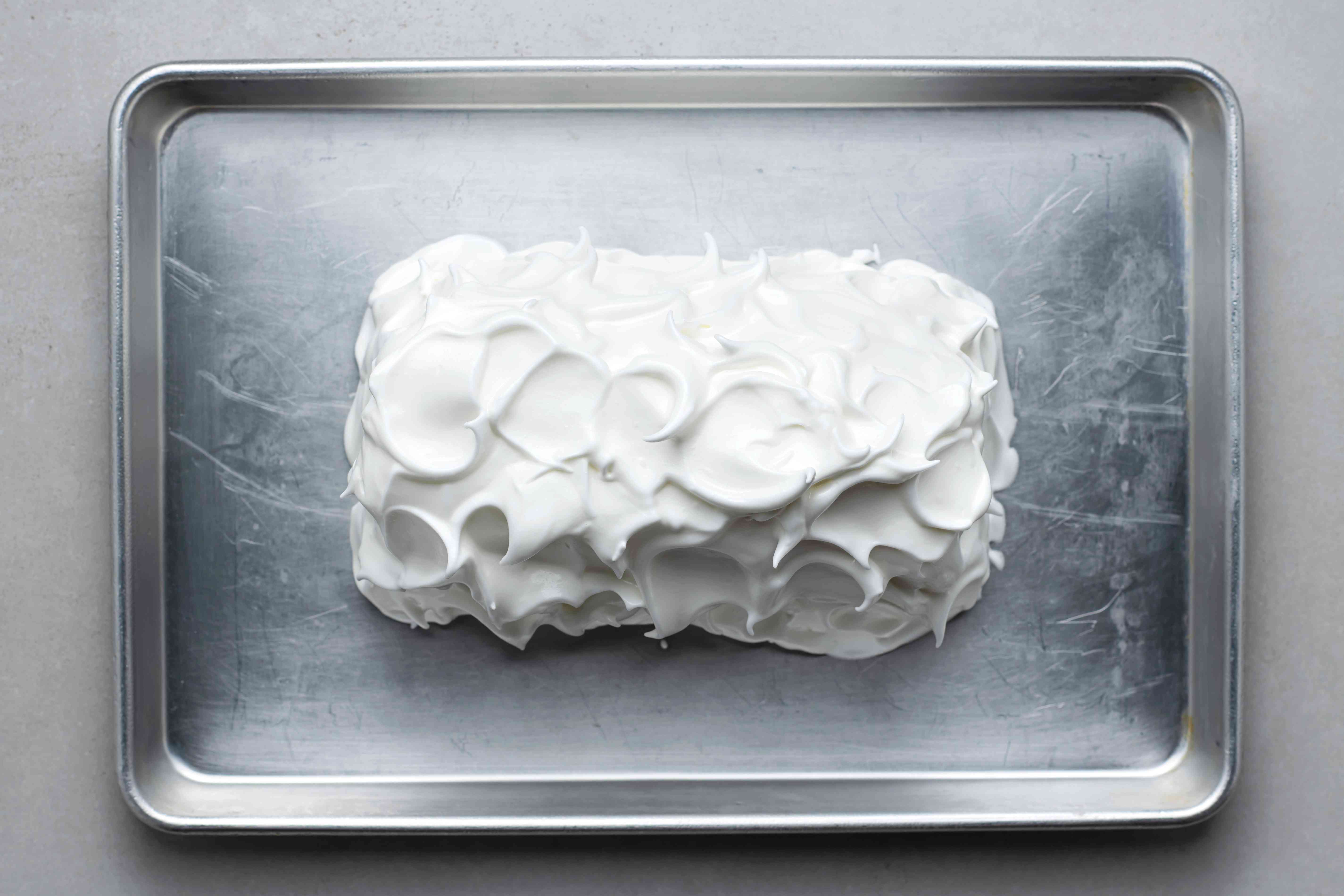 ice cream and cake covered with the meringue mixture