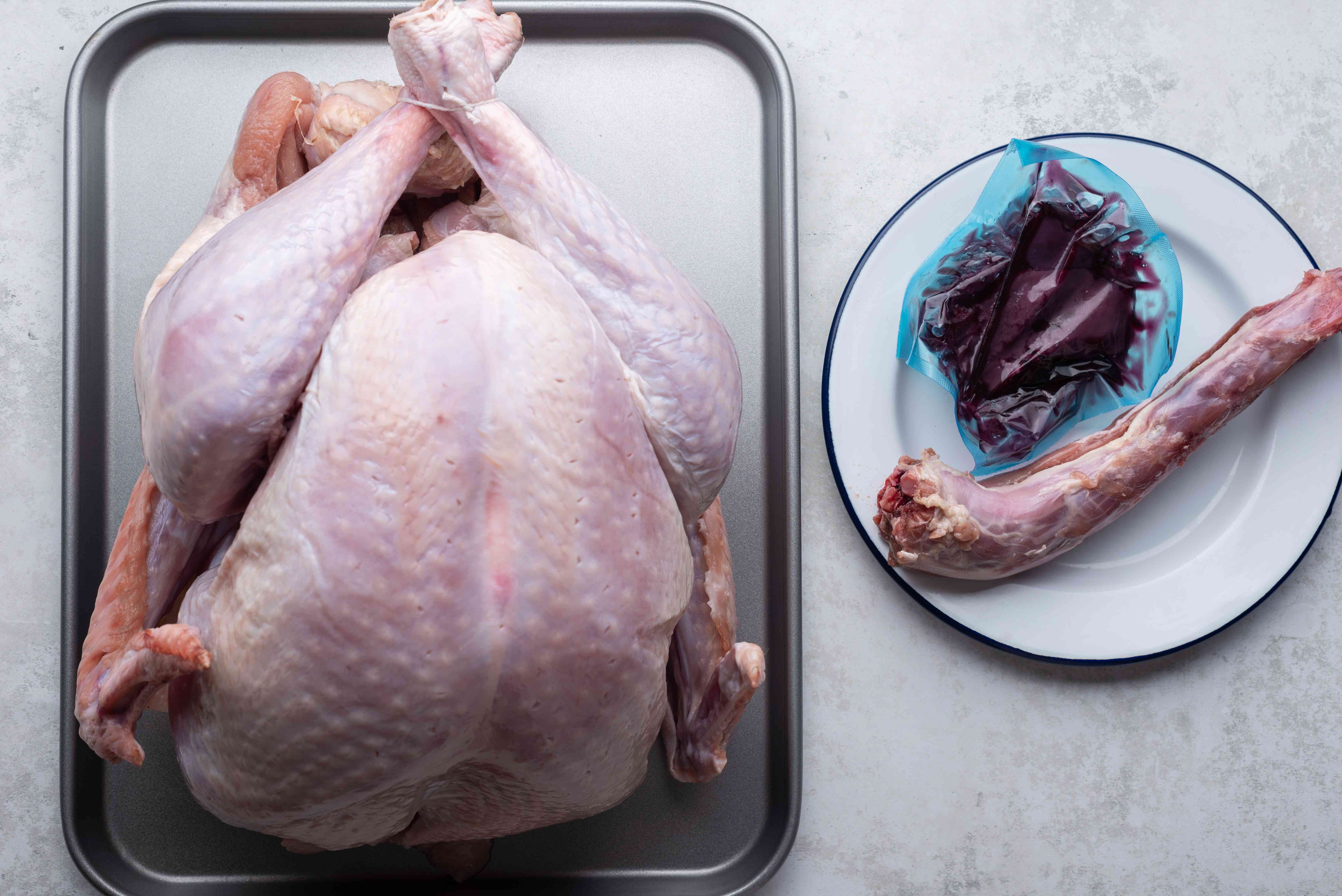 turkey on a baking sheet with neck and giblets removed