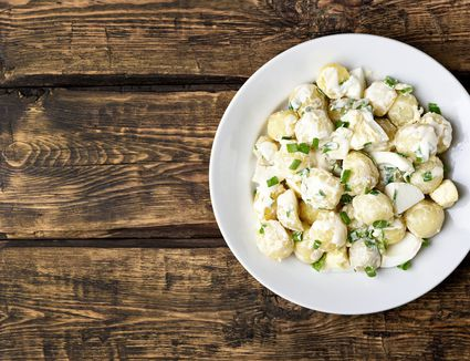 Potato salad with eggs and green onions
