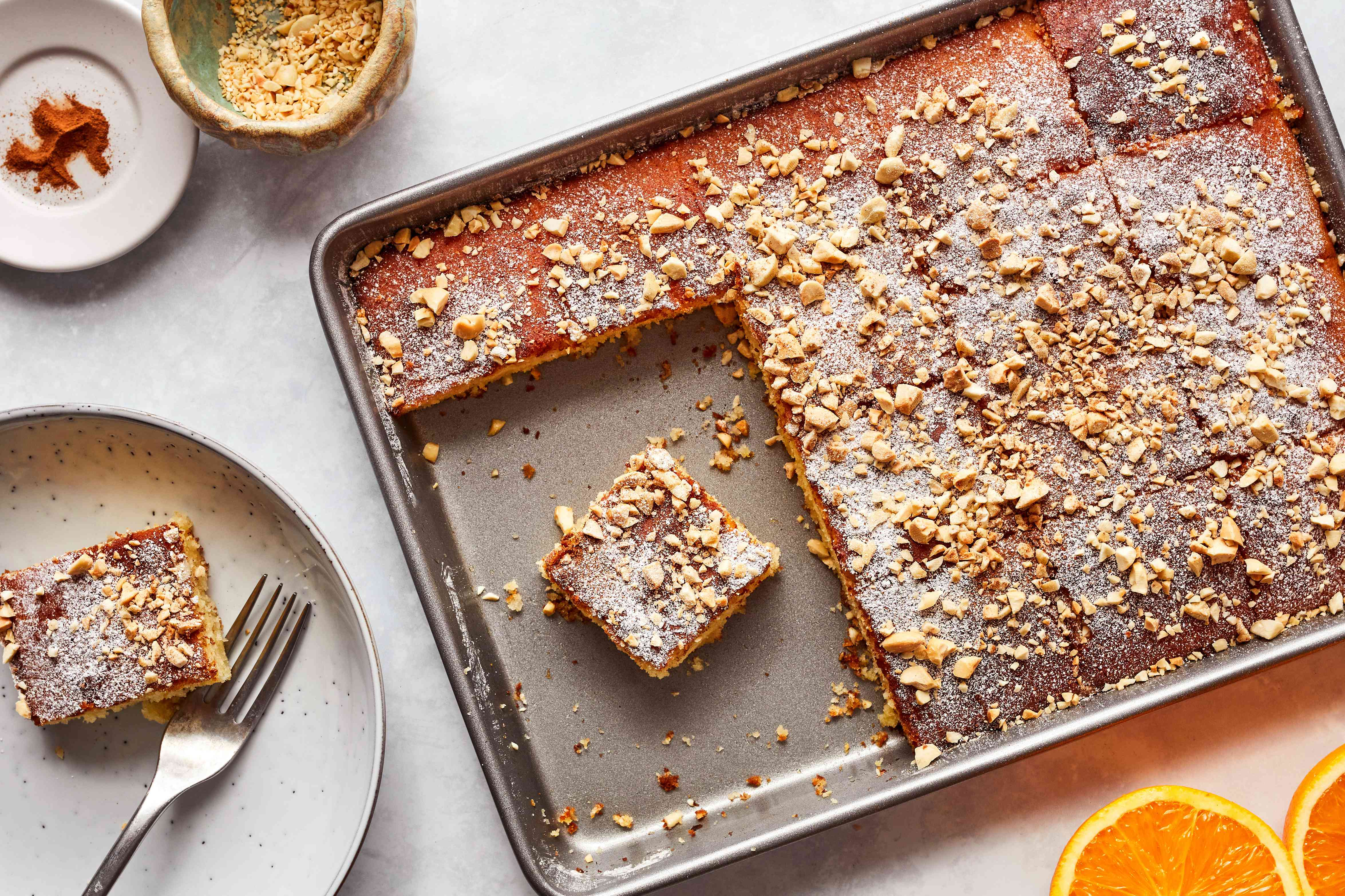 Revani cake with orange syrup and almonds; cut into squares
