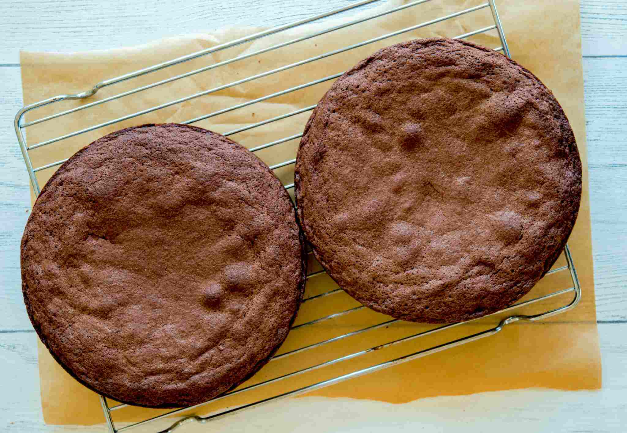 Chocolate cakes cooling on rack