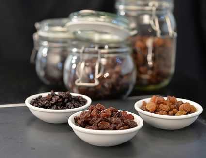 Raisins, currants, and sultanas separated into bowls