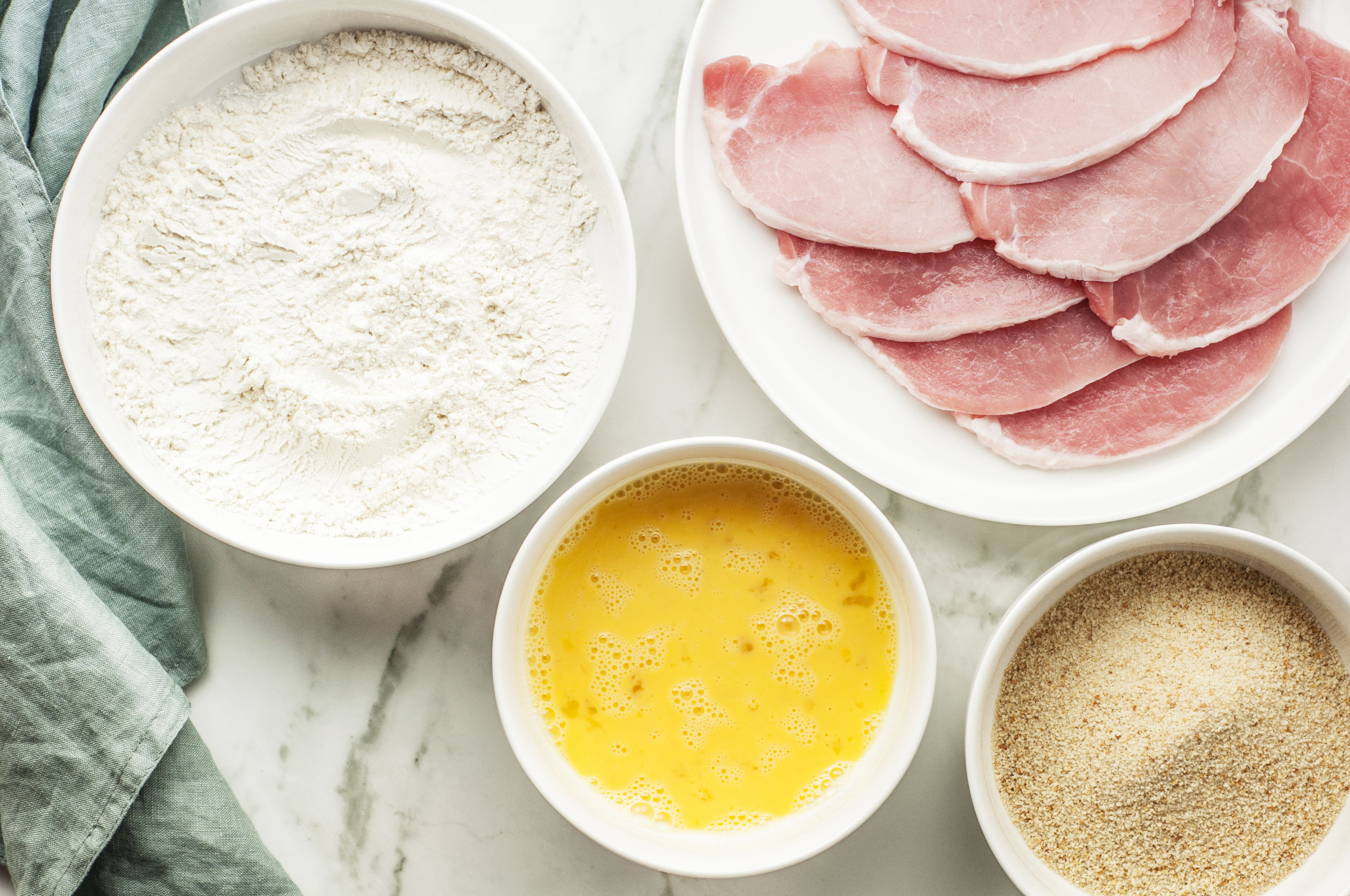 flour, salt, bread crumbs with cutlets