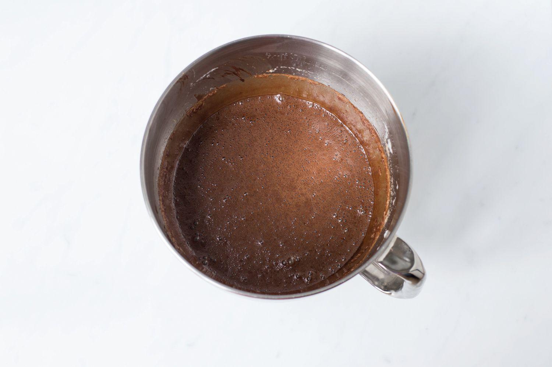 Adding chocolate to beaten egg whites.