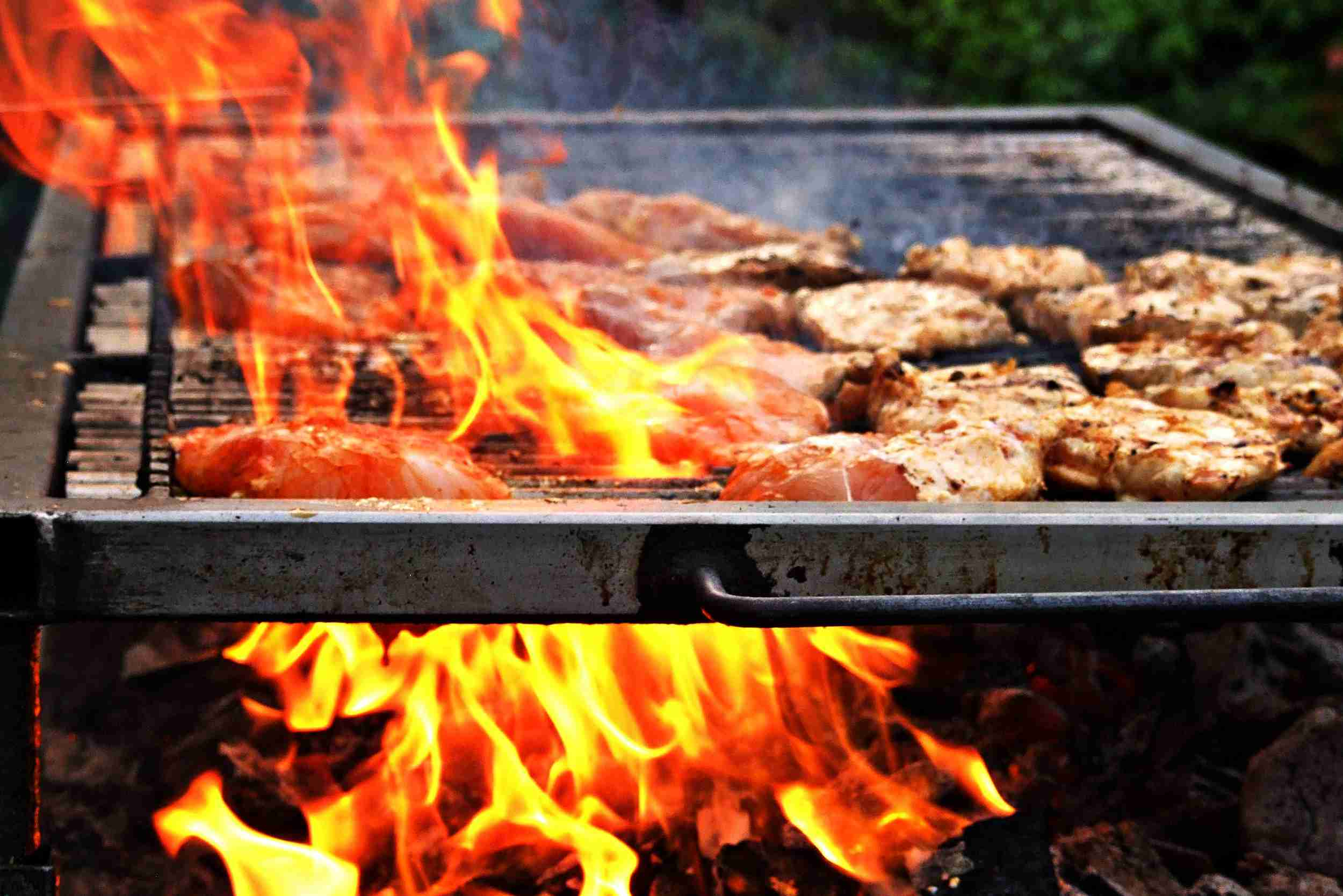 A large grill flare-up while grilling chicken