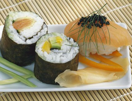 Two Maki-Sushi and one Nigiri-Sushi on plate with Ginger