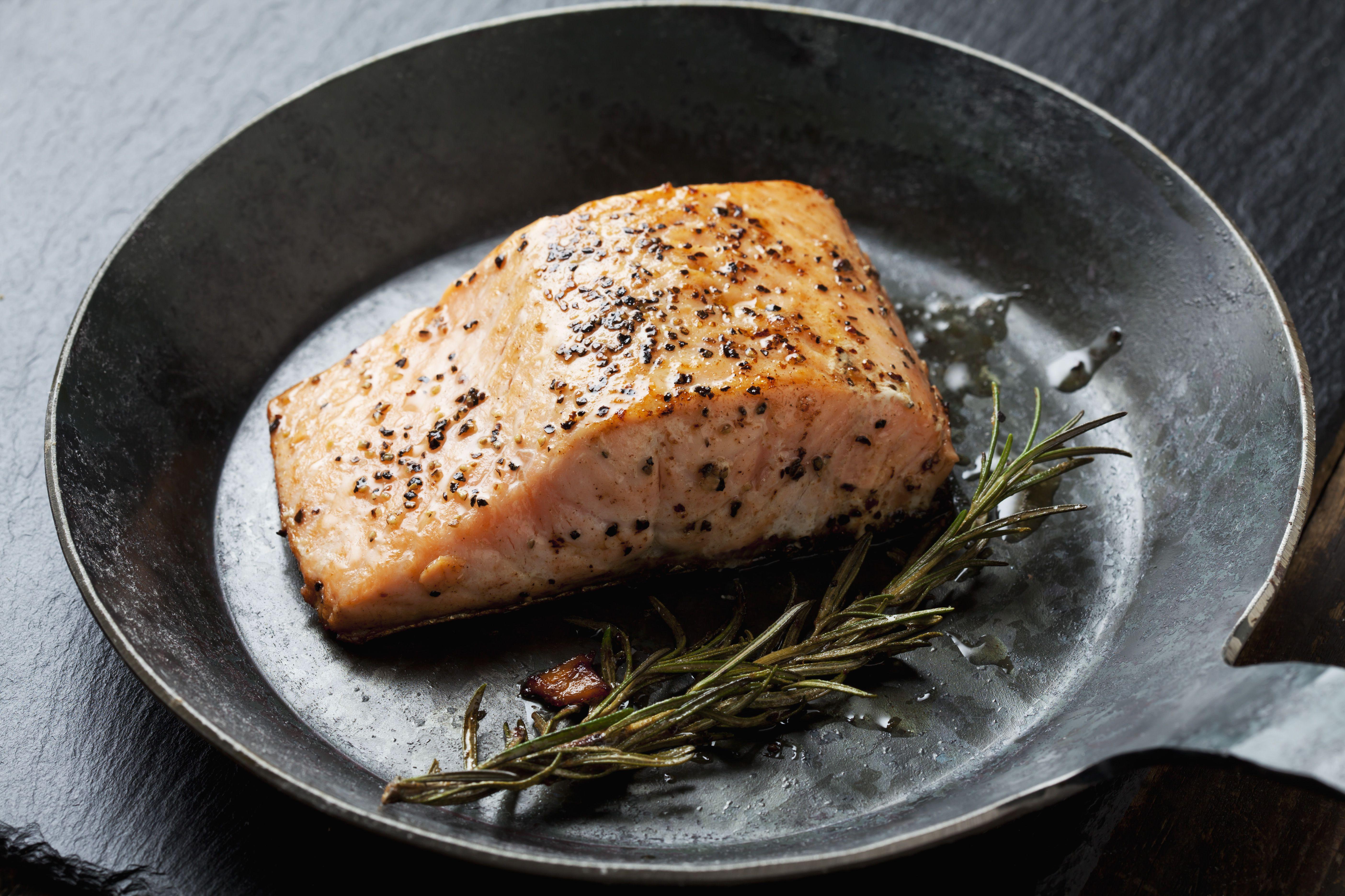 Fried salmon fillet in a frying pan