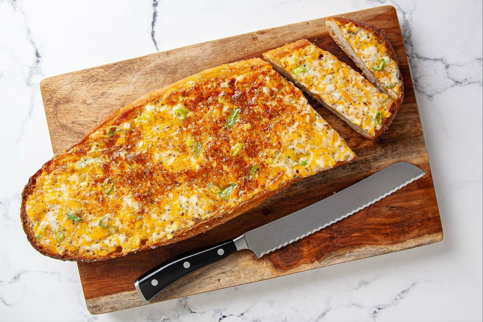 cheesy garlic bread on cutting board