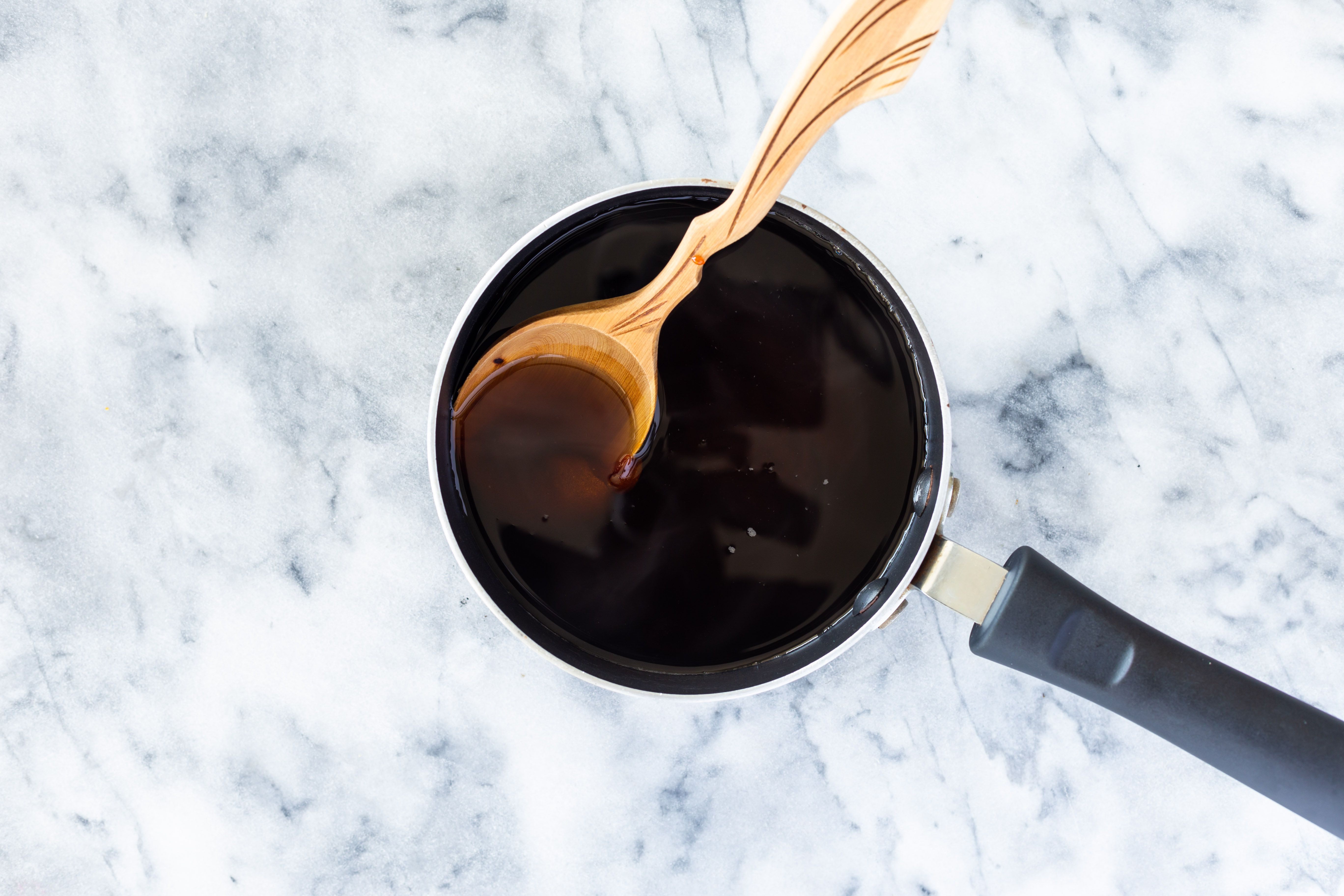 Mixing caramelized sugar with melted brown sugar