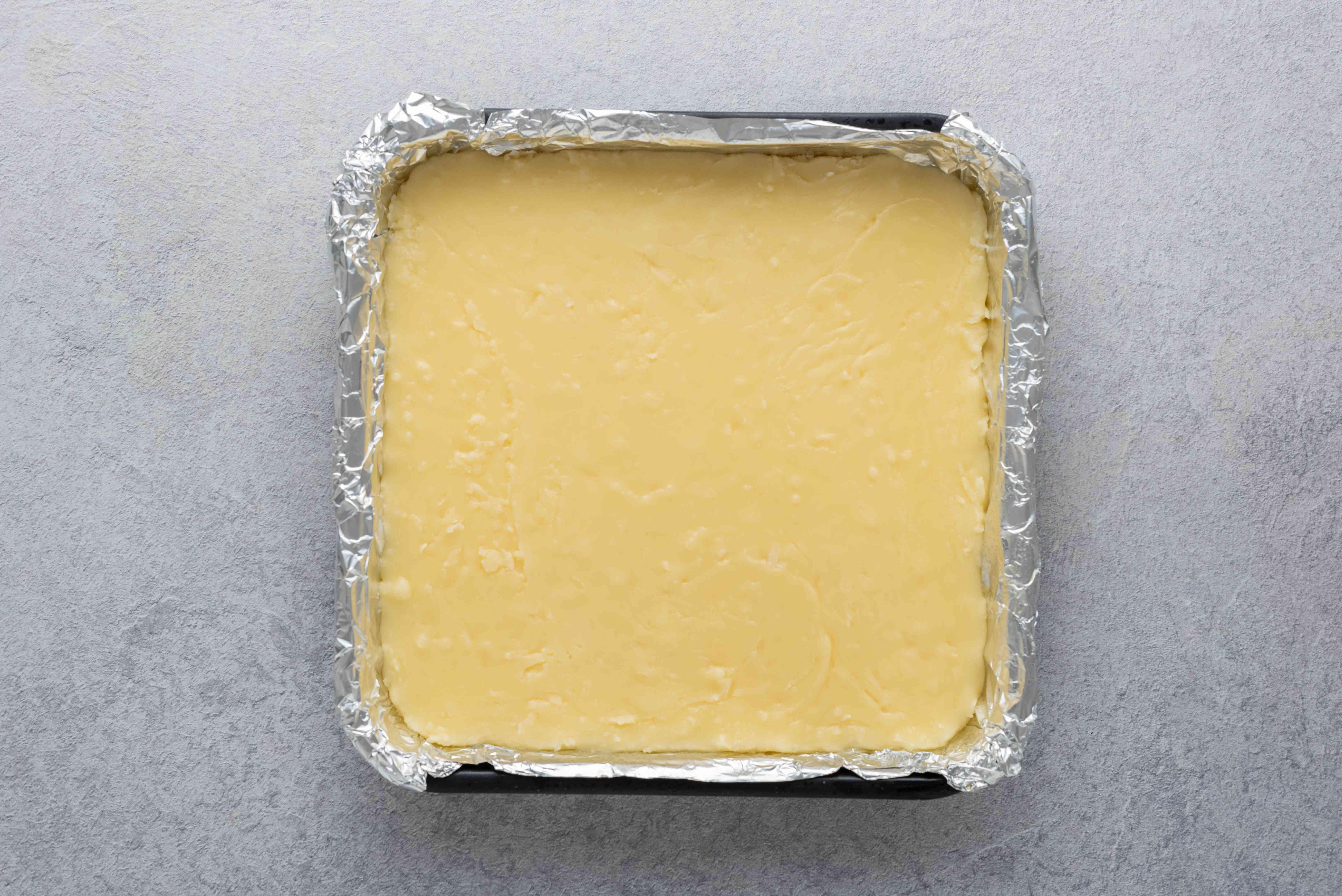 fudge in an aluminum foil lined baking pan