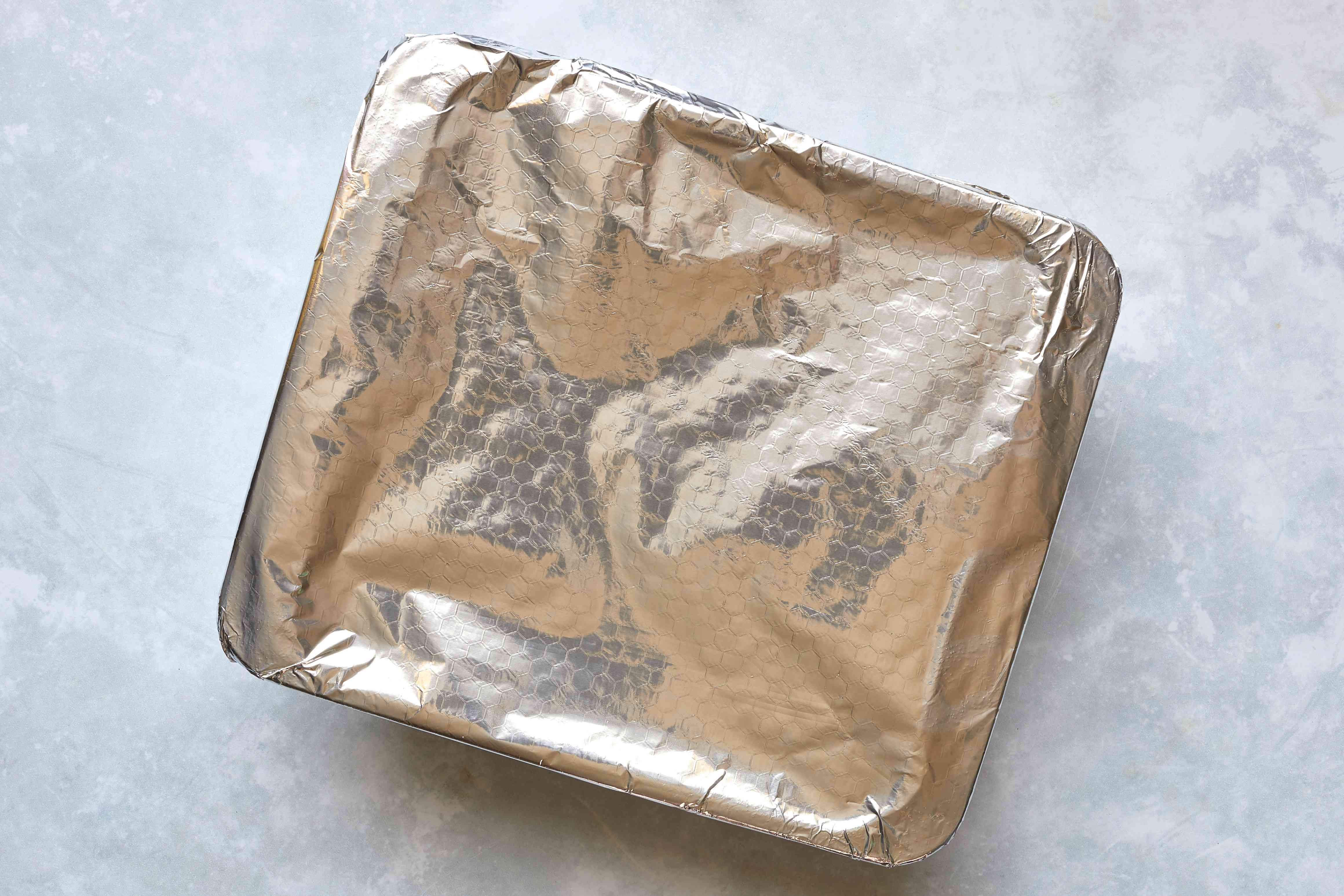 bacon and egg casserole covered in aluminum foil