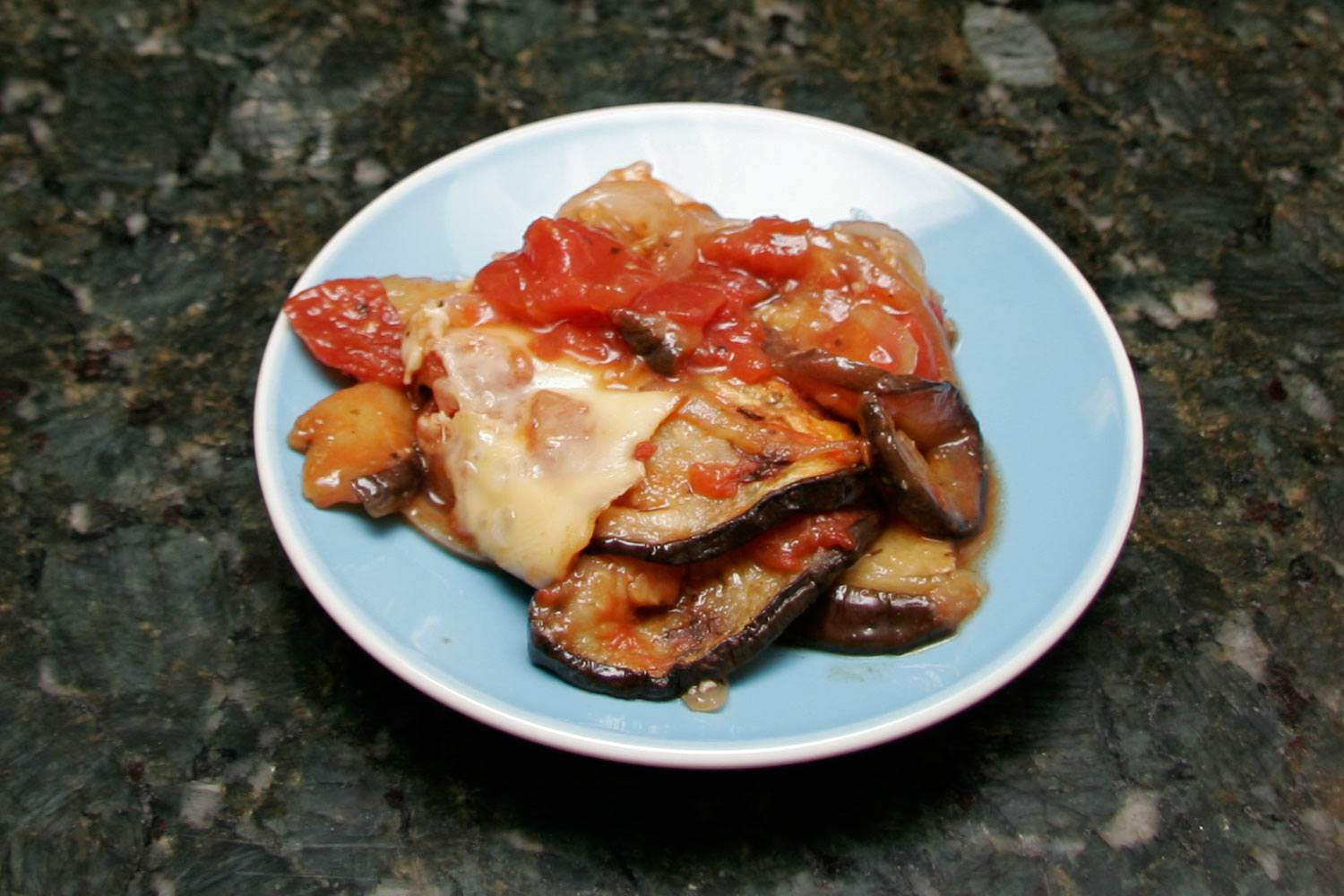 Eggplant with Sweet Onions and Tomatoes and Mozzarella Cheese