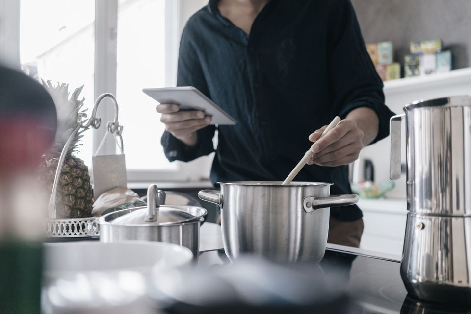 man-using-stainless-cookware