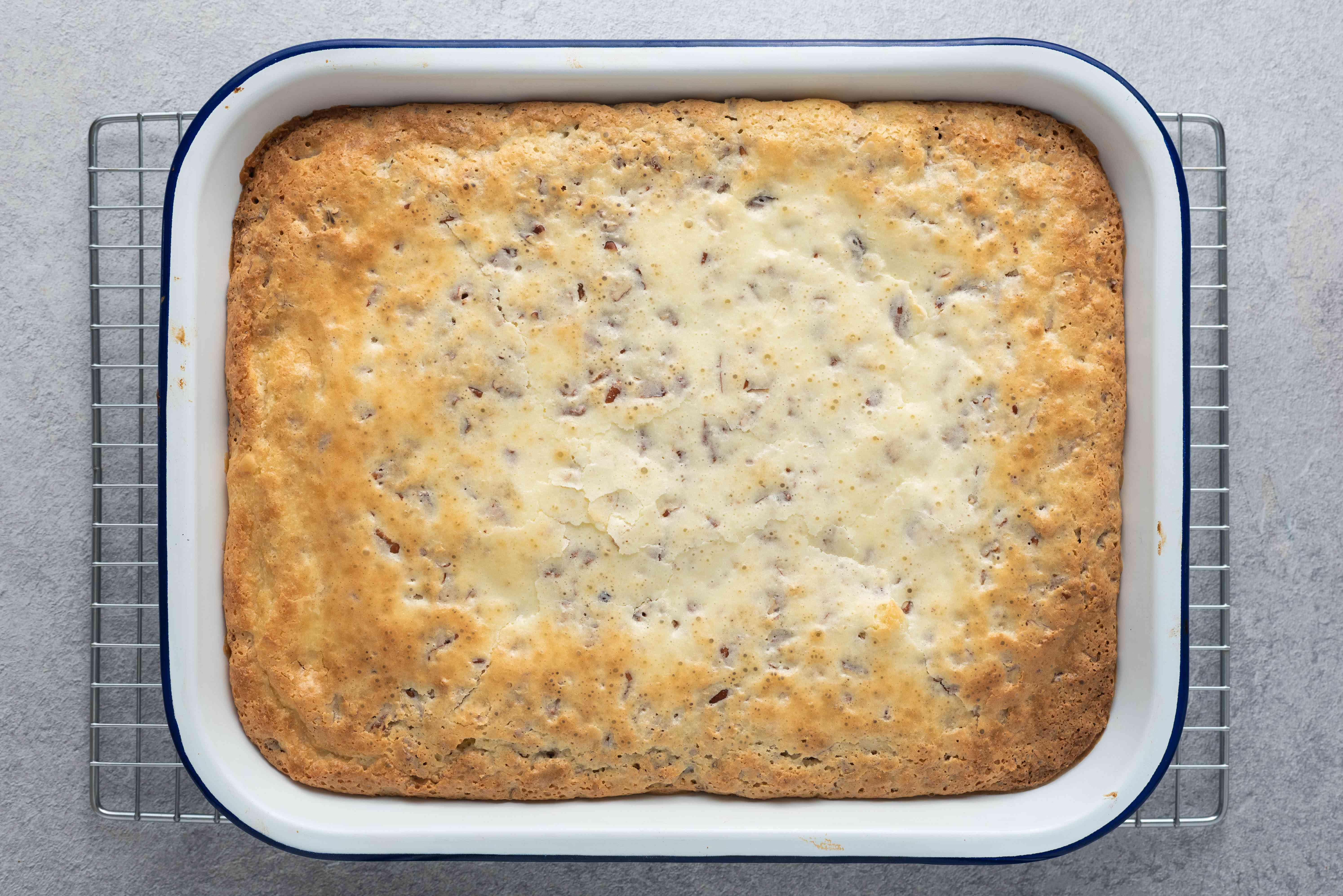cake in a baking dish cooling on a wire rack