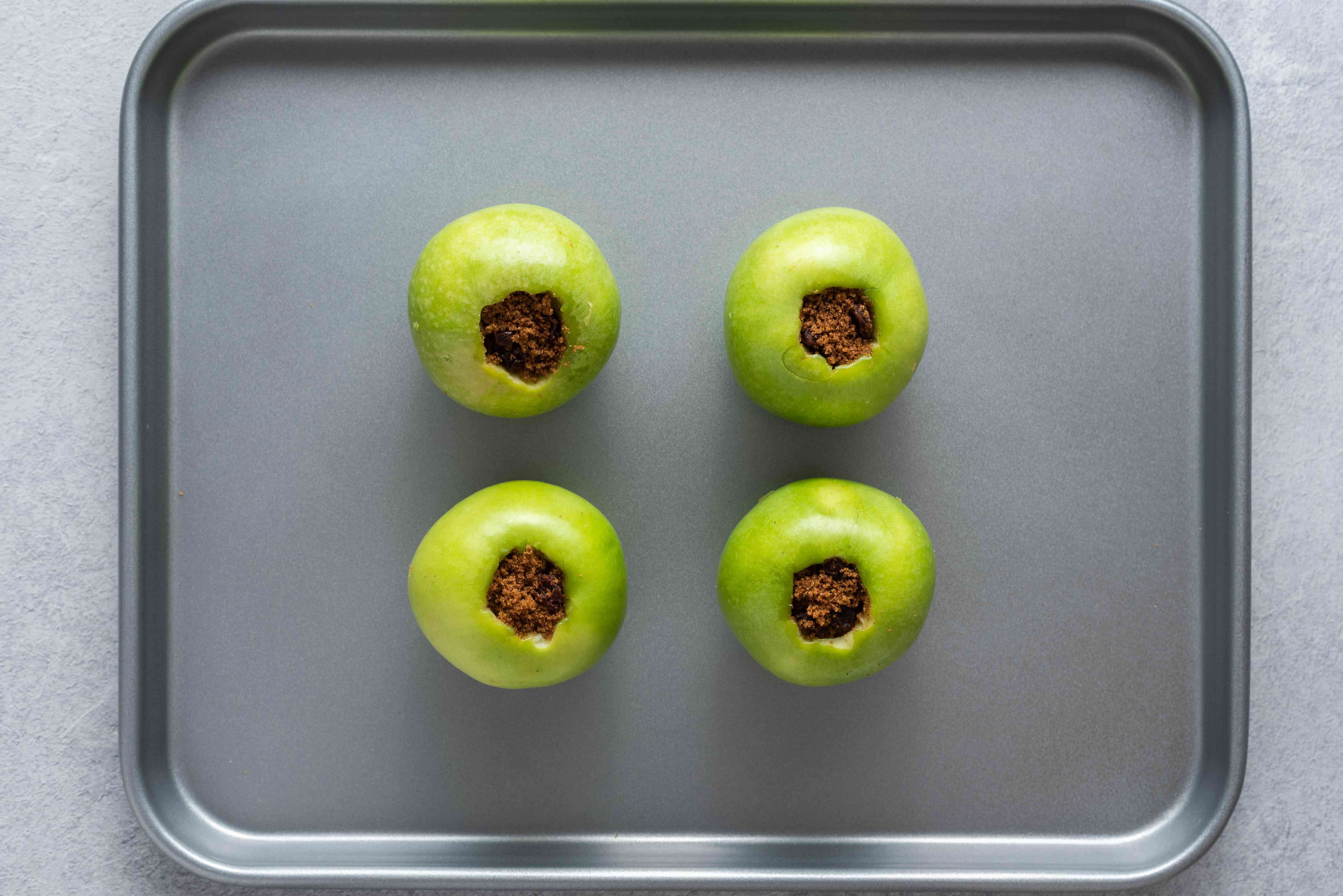 Apples with a sugar and raisin mixture inside