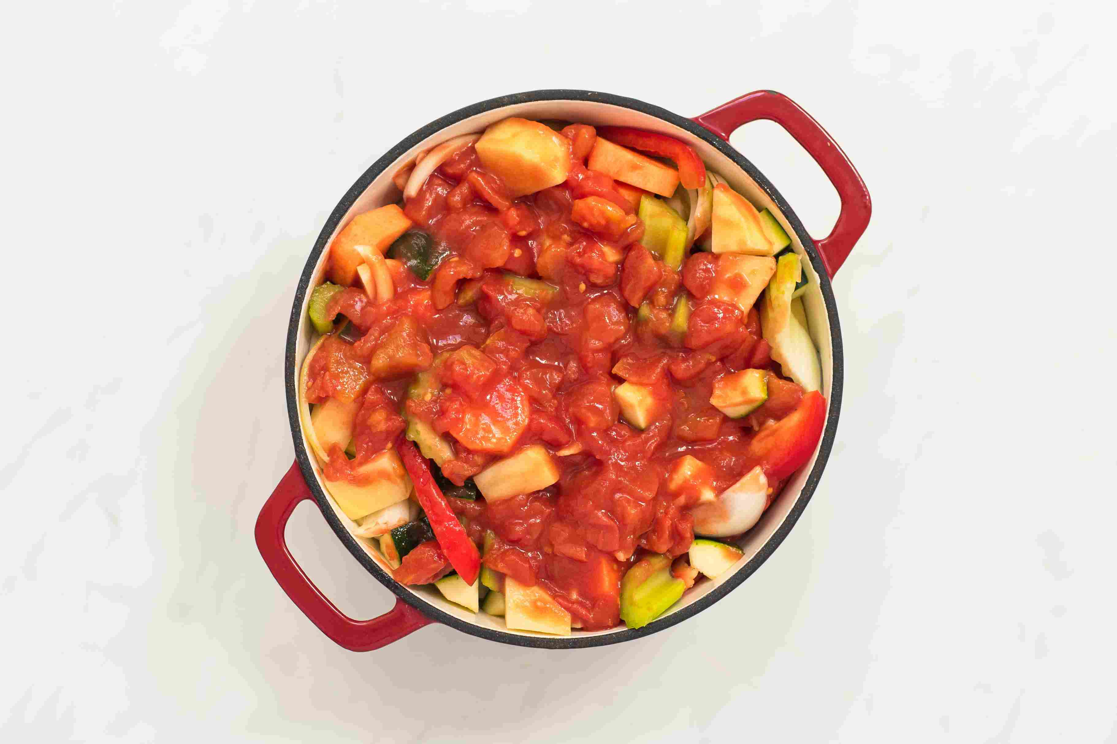 Add tomatoes and tomato liquid to pot