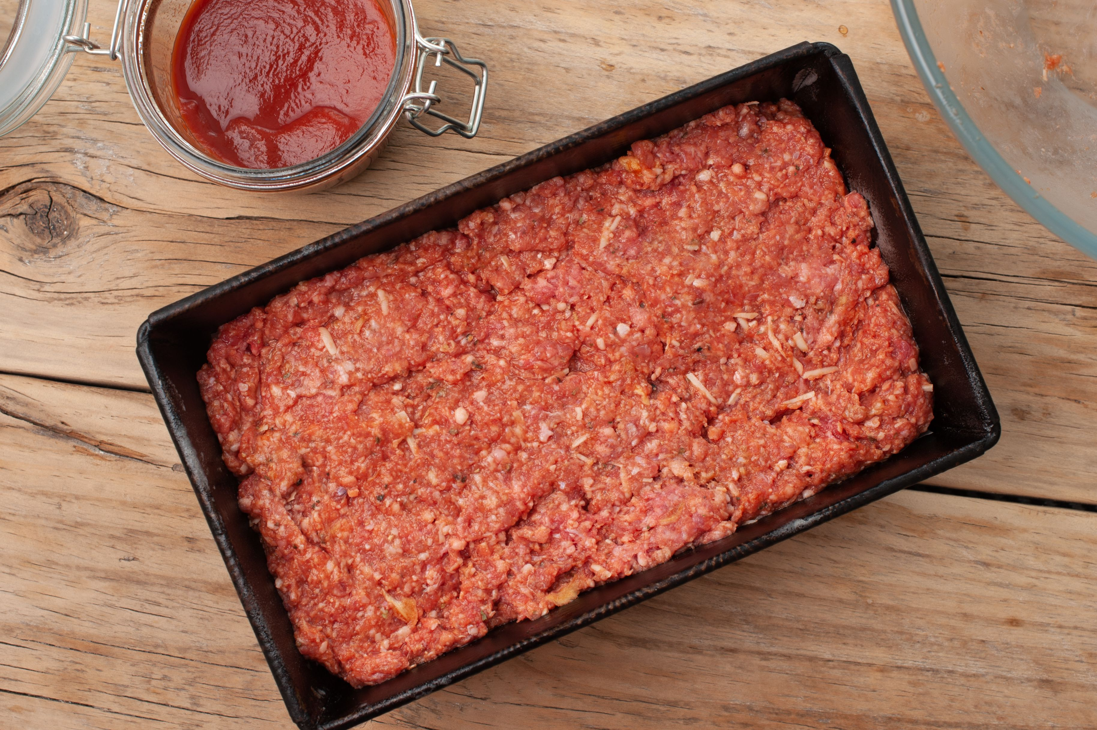 Pack meat into pan