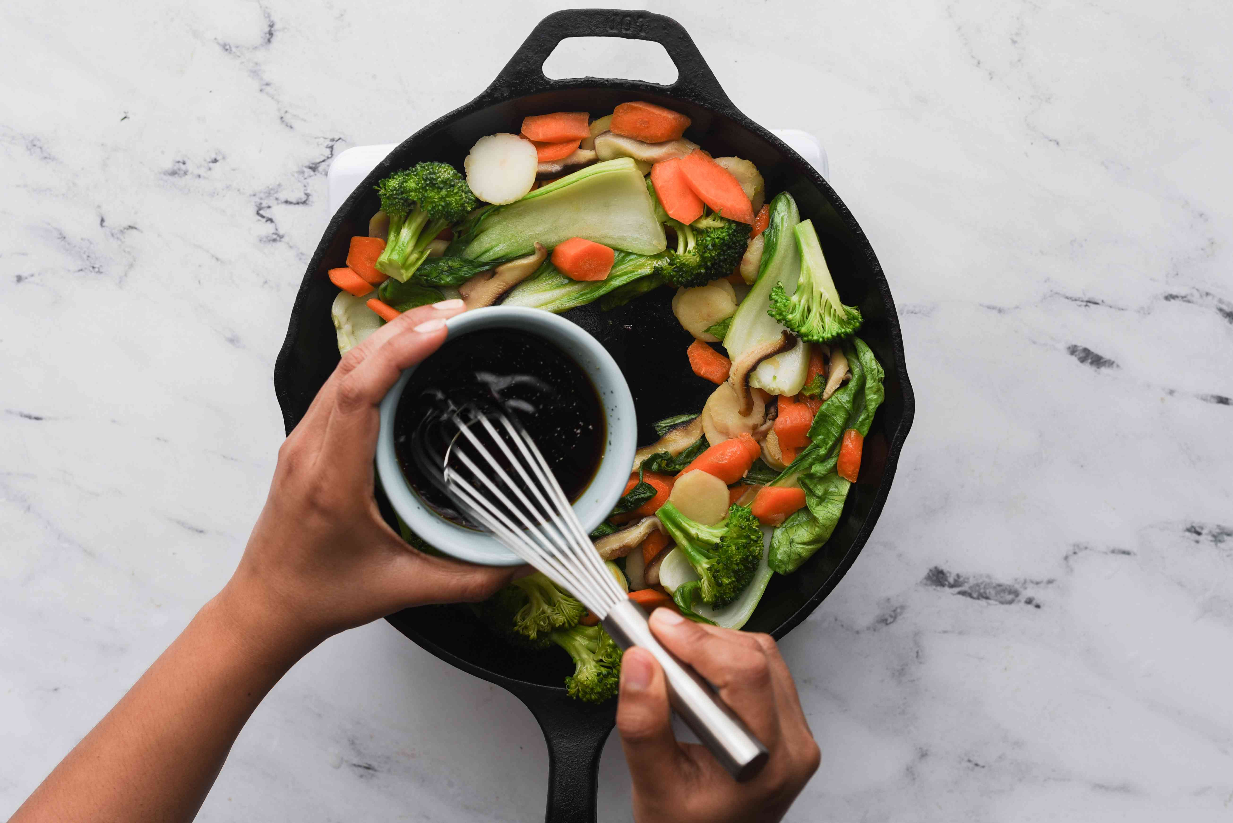pour sauce into the skillet with the vegetables