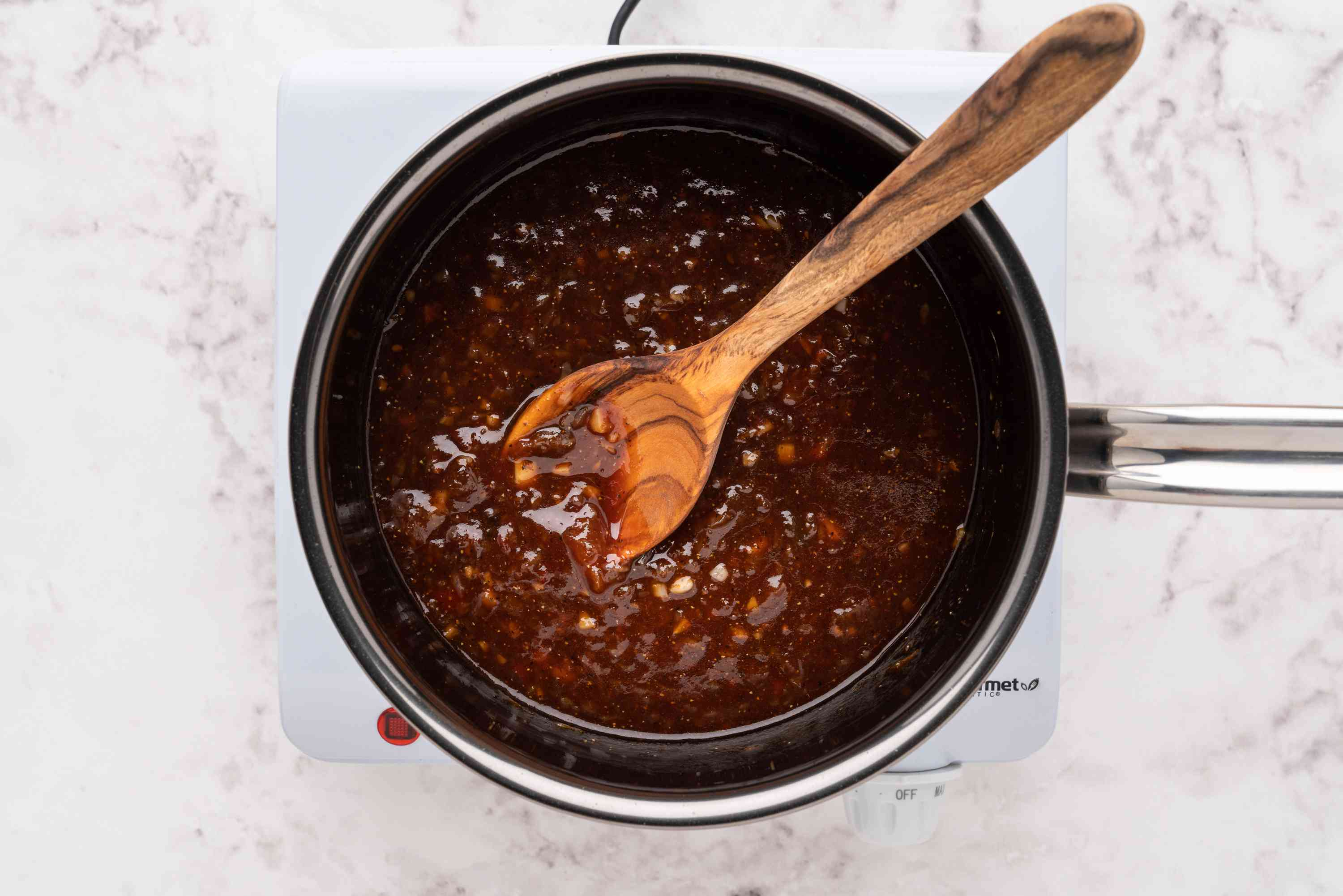 apricot chili glaze cooking in a saucepan