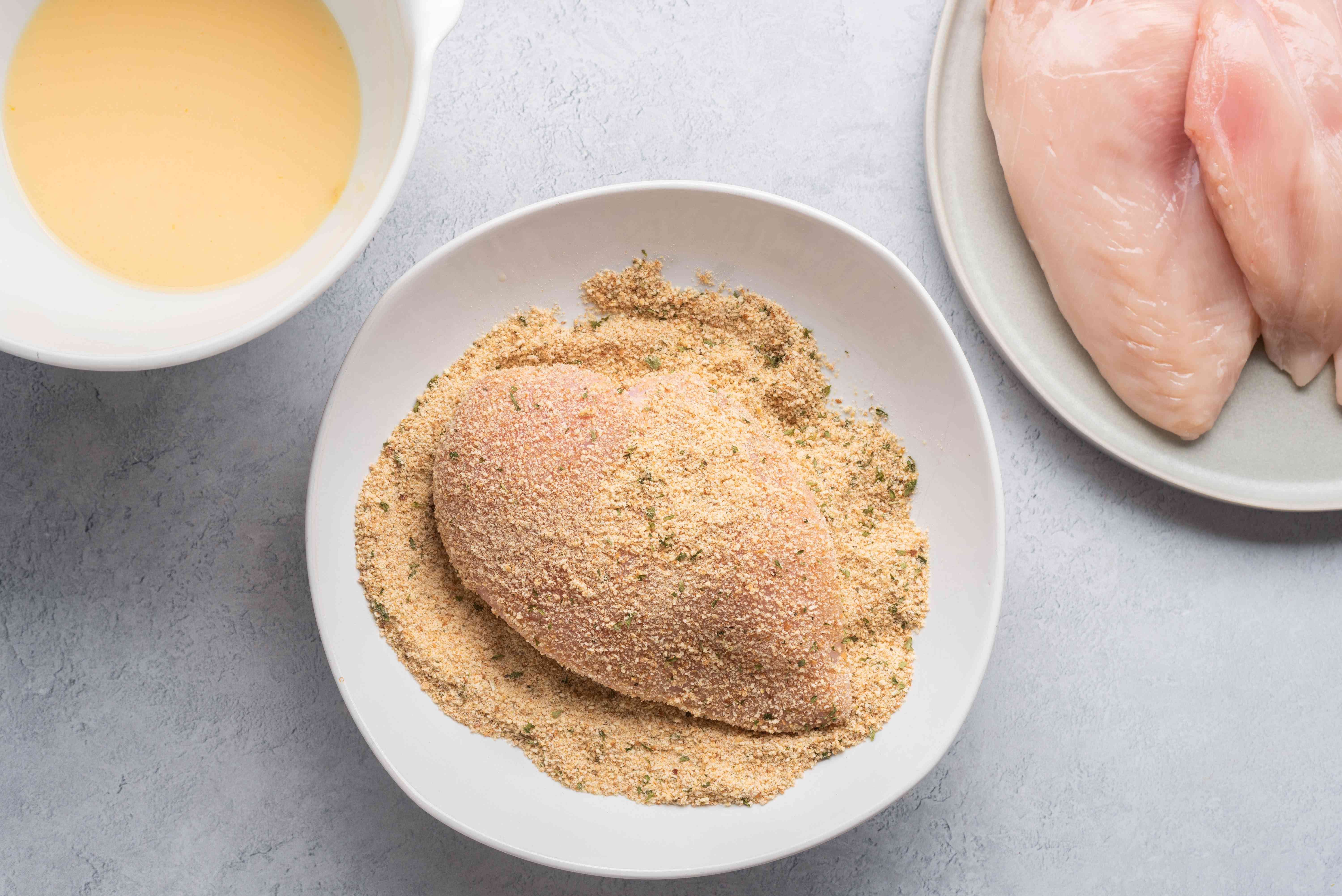 Dip the flattened chicken breasts in the milk and egg mixture and then in the seasoned breadcrumbs