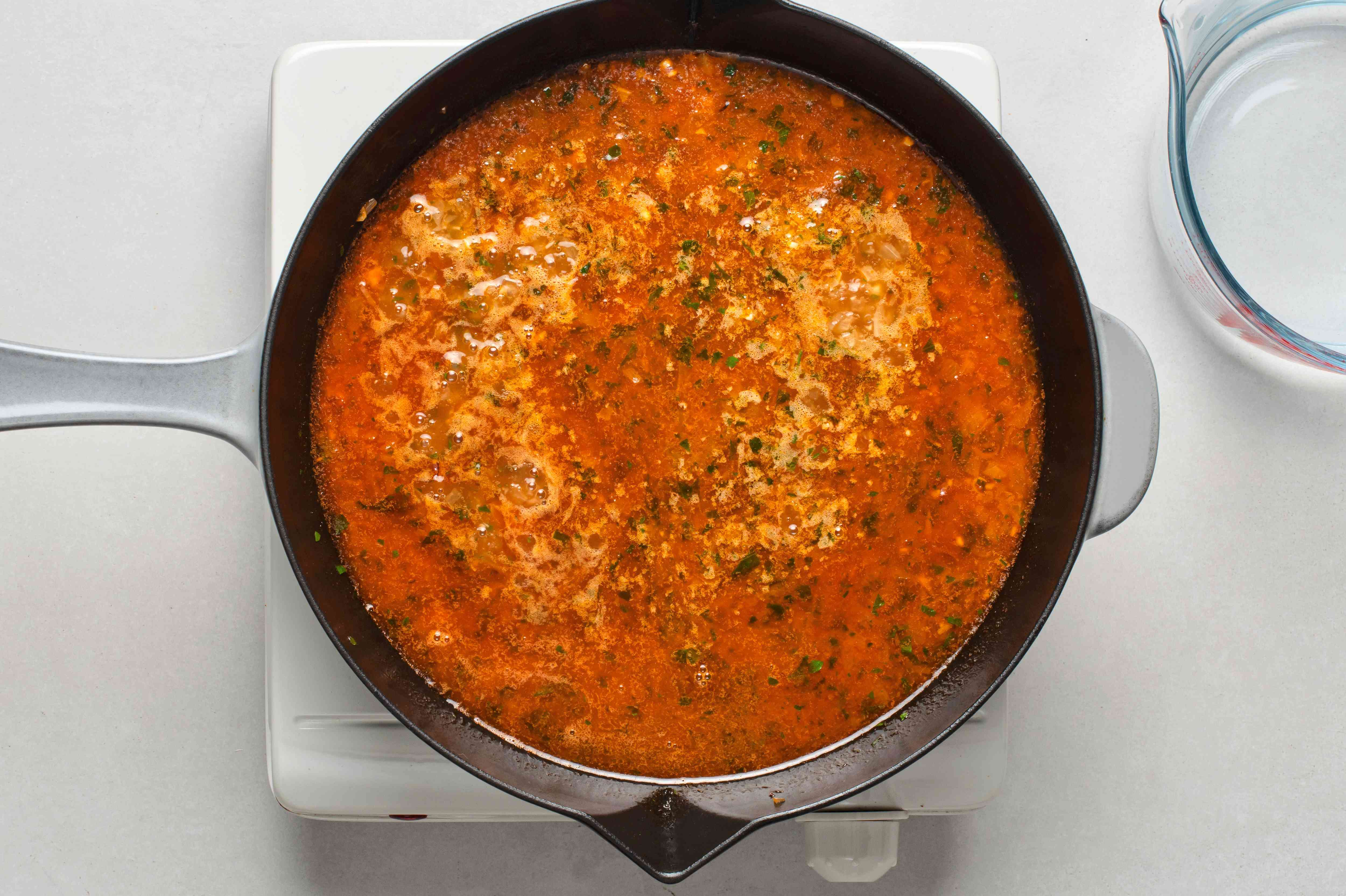 A pan with tomato mixture boiling