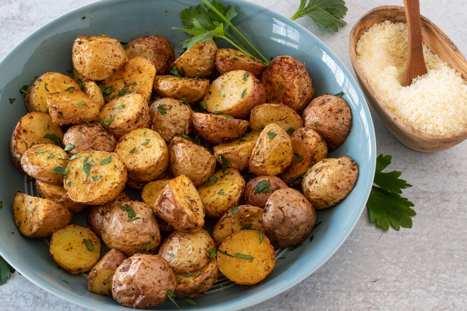 air fryer potatoes with parsley garnish and parmesan cheese