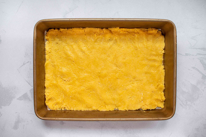 Pumpkin cake mixture in a baking pan