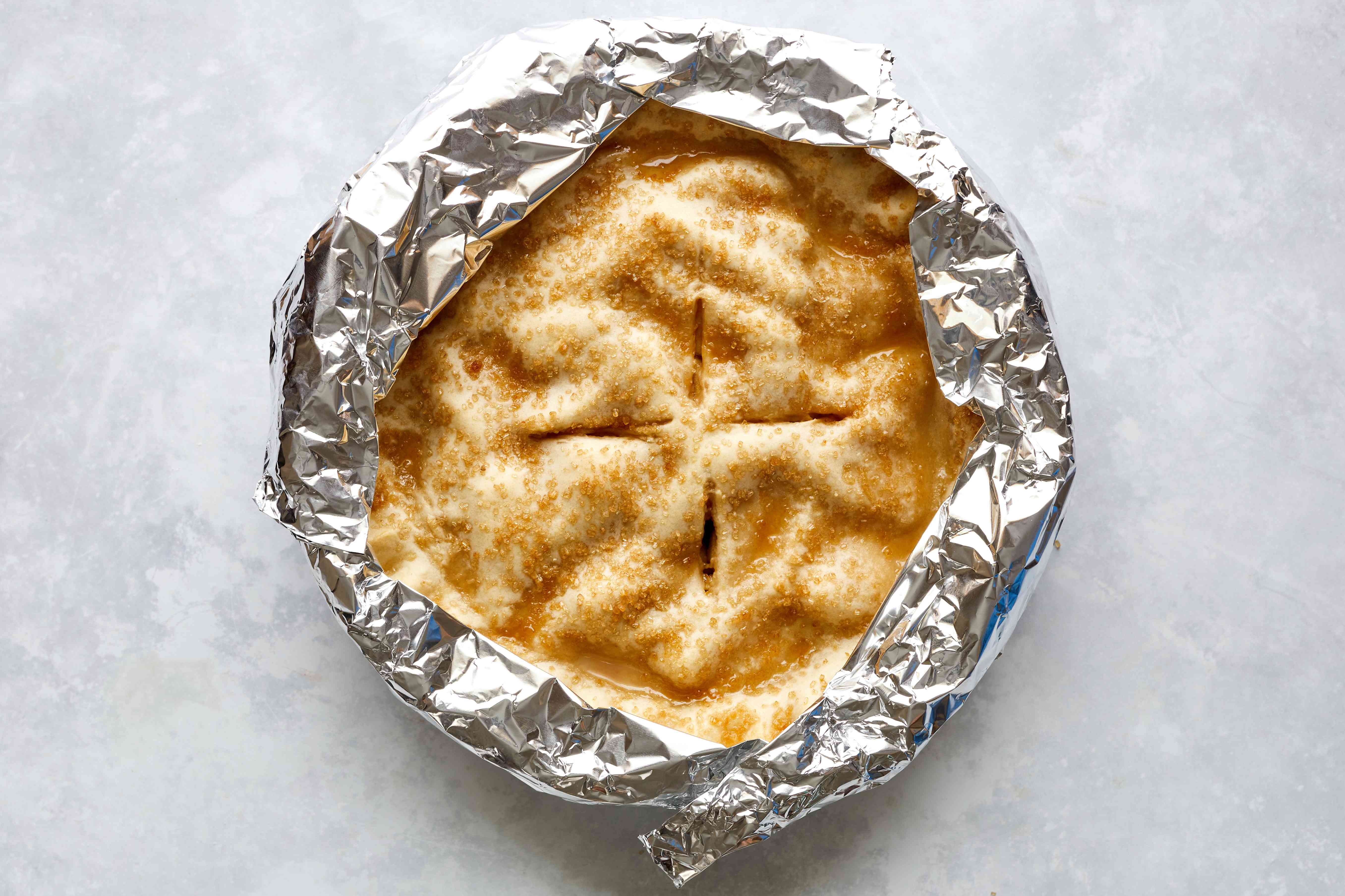 Apple pie wrapped with aluminum foil on the sides