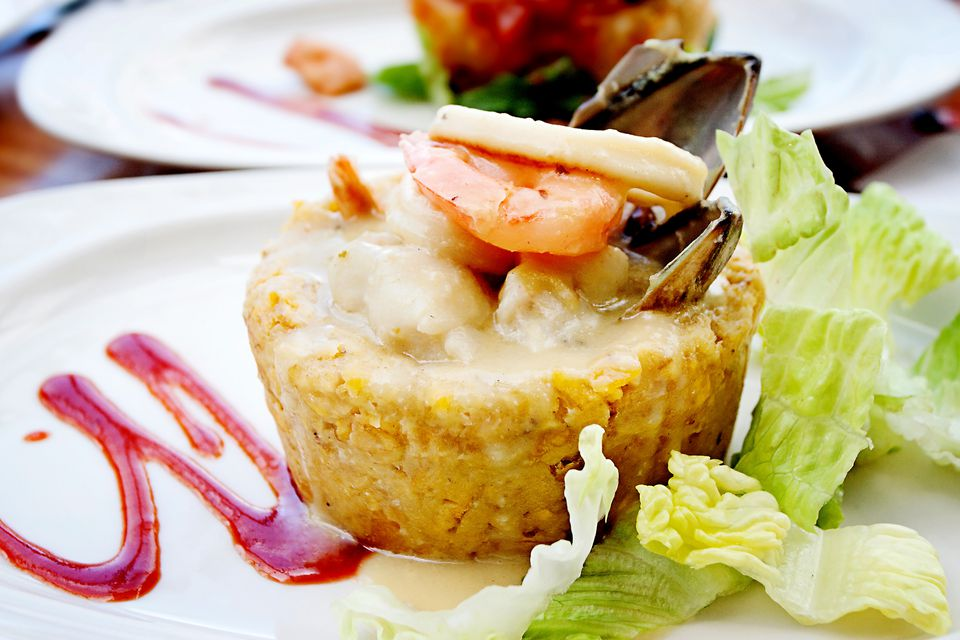 Puerto Rican mofongo served with seafood