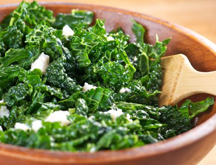 Kale salad in a wooden bowl