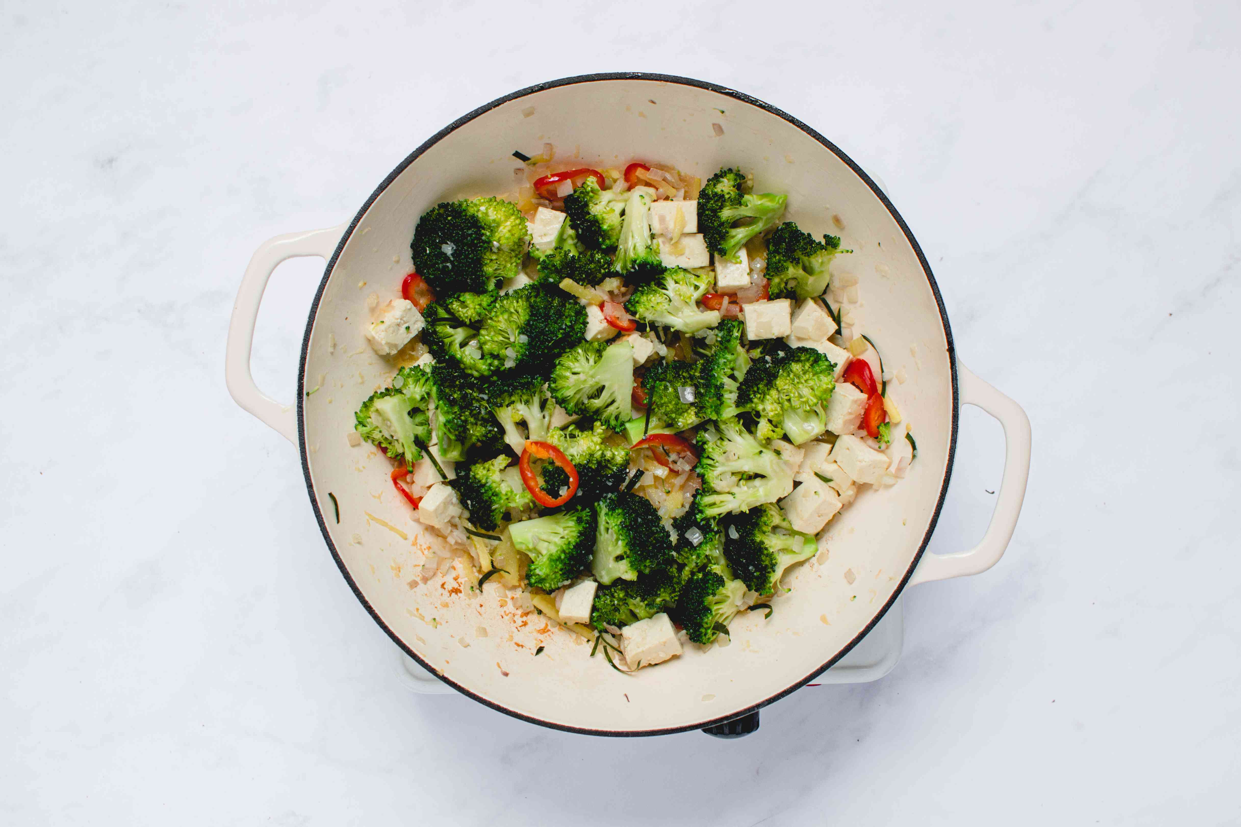 Add the broccoli to the tofu mixture in the pan