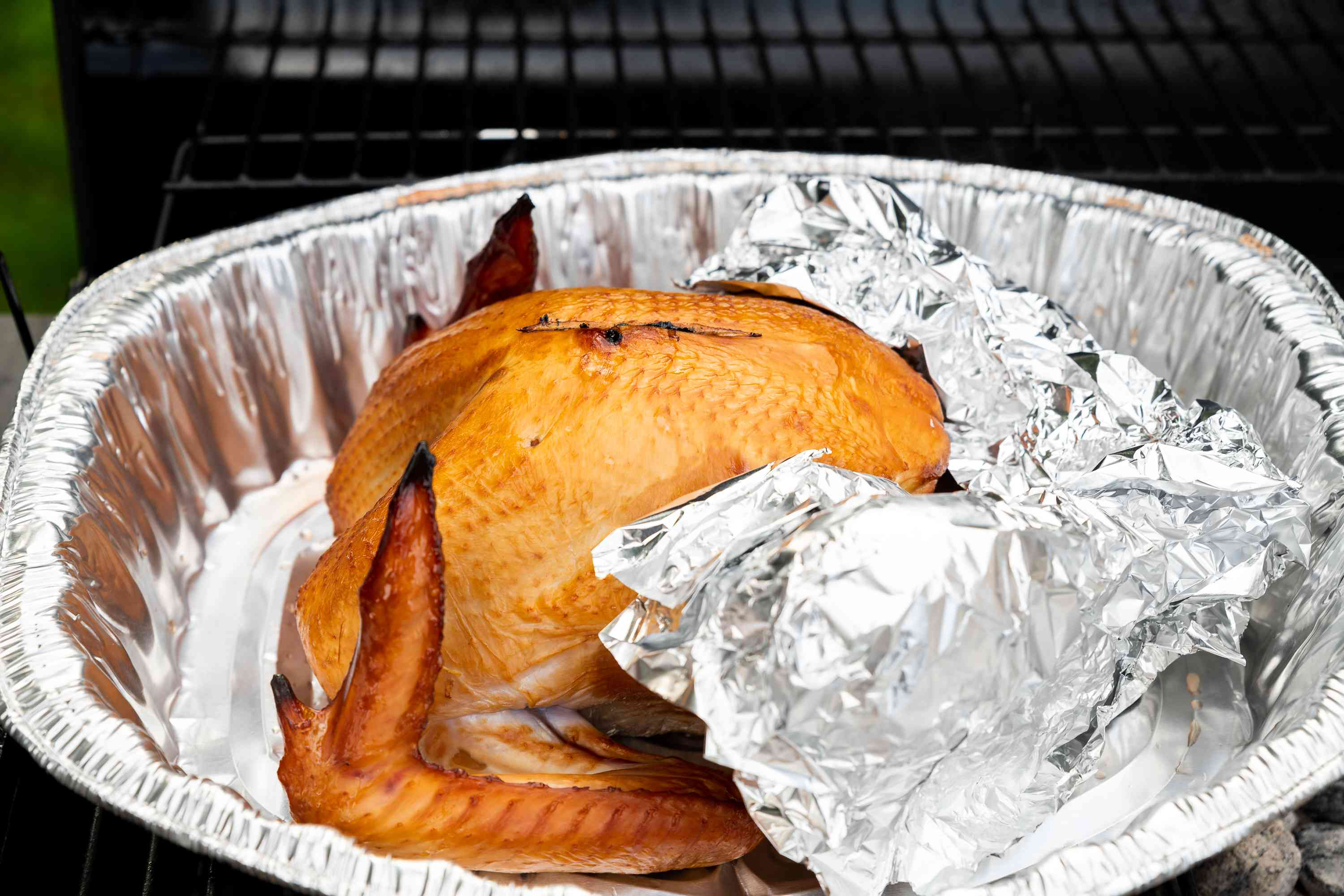 wrap the bird in foil to keep them from burning