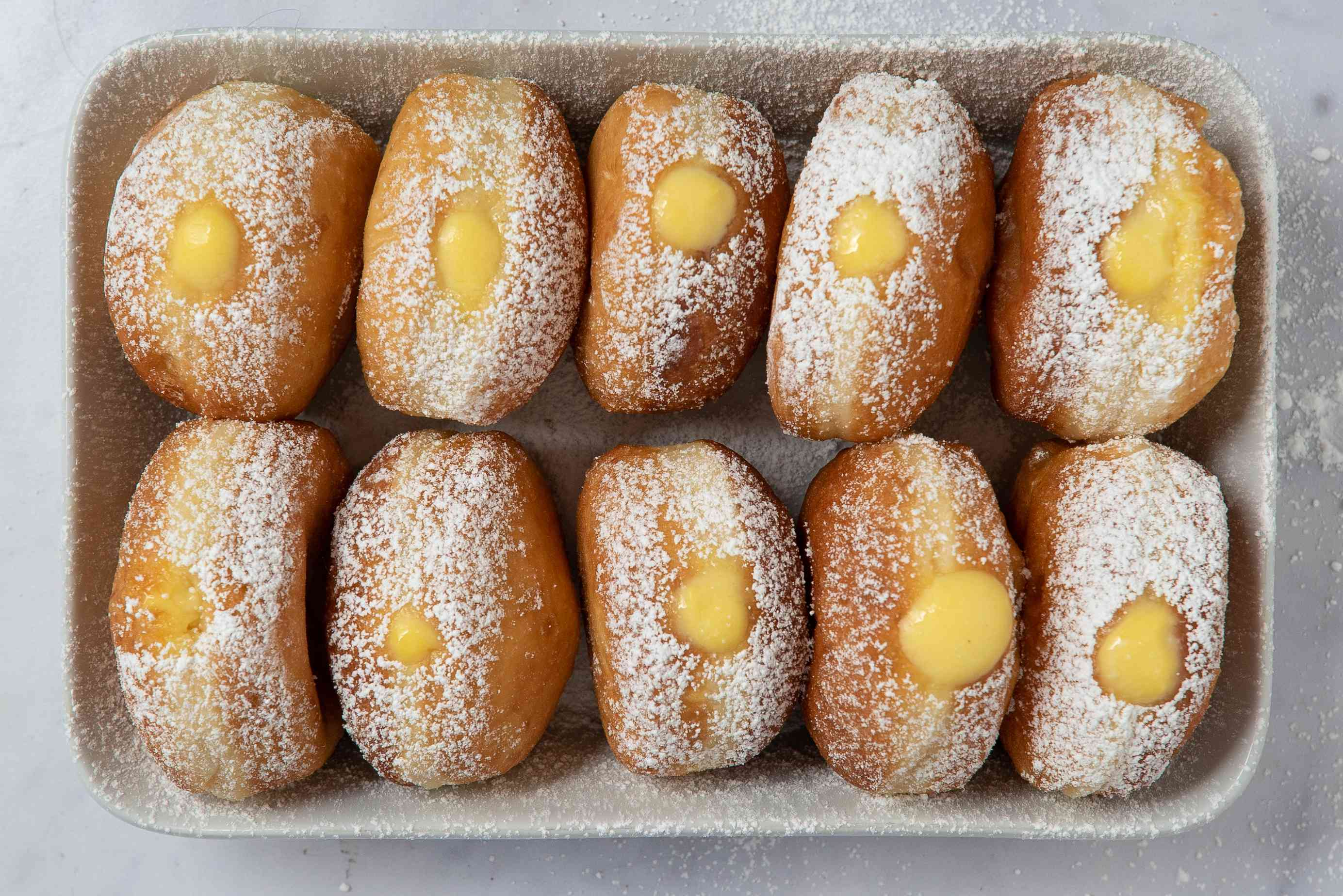 Cream Filled Doughnuts with powdered sugar on top