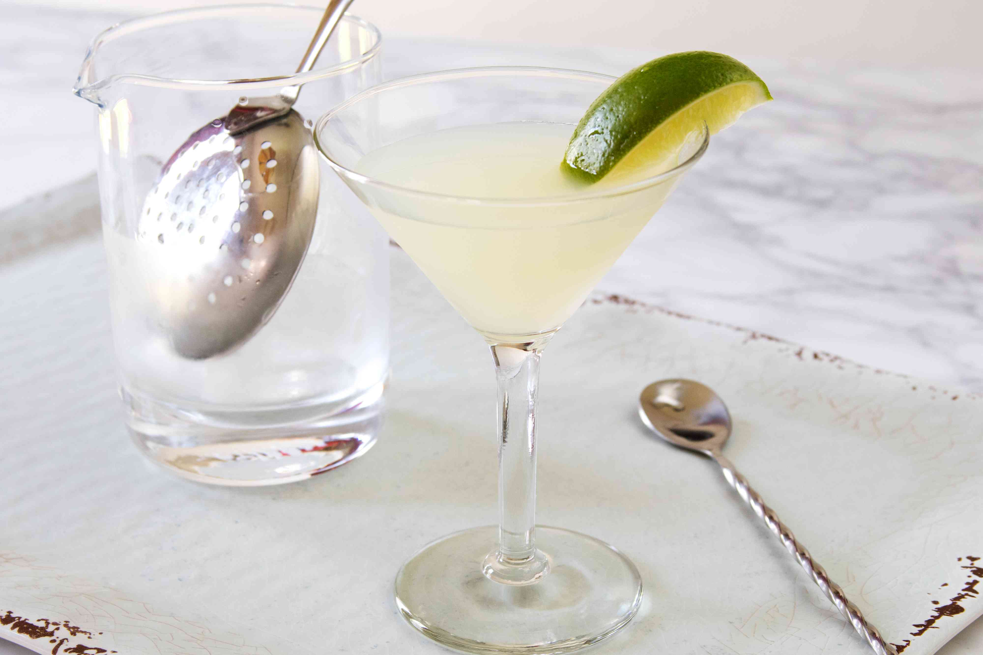 Classic gimlet cocktail garnished with lime wedge