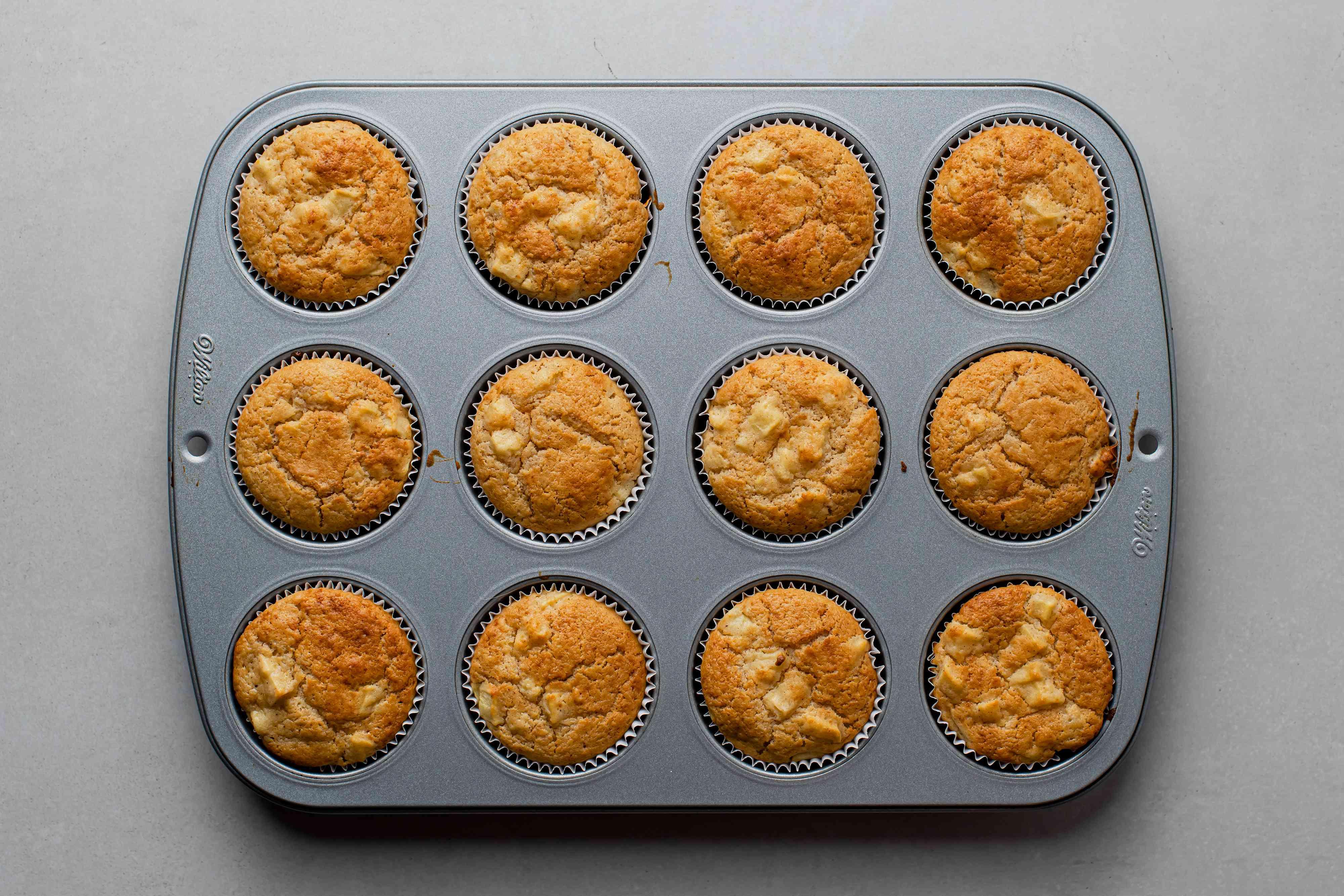 Apple Cinnamon Muffins in muffin tins