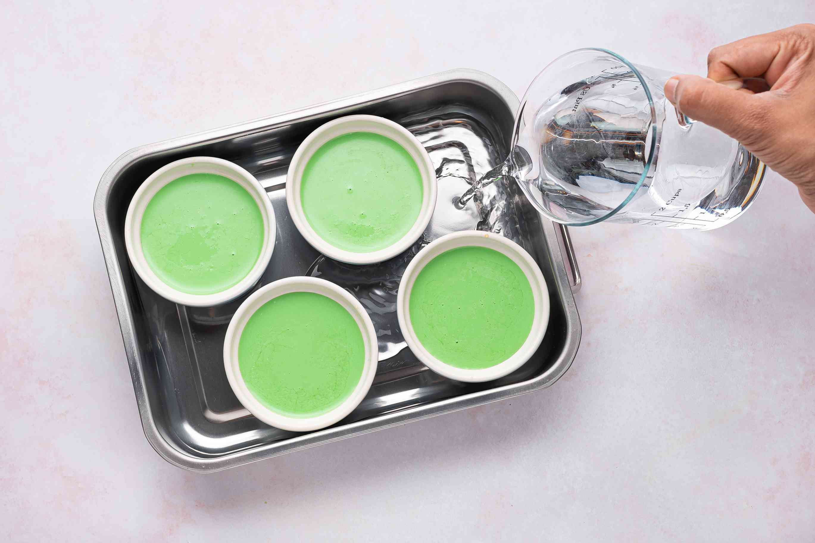 Place ramekins in a large glass baking dish with water
