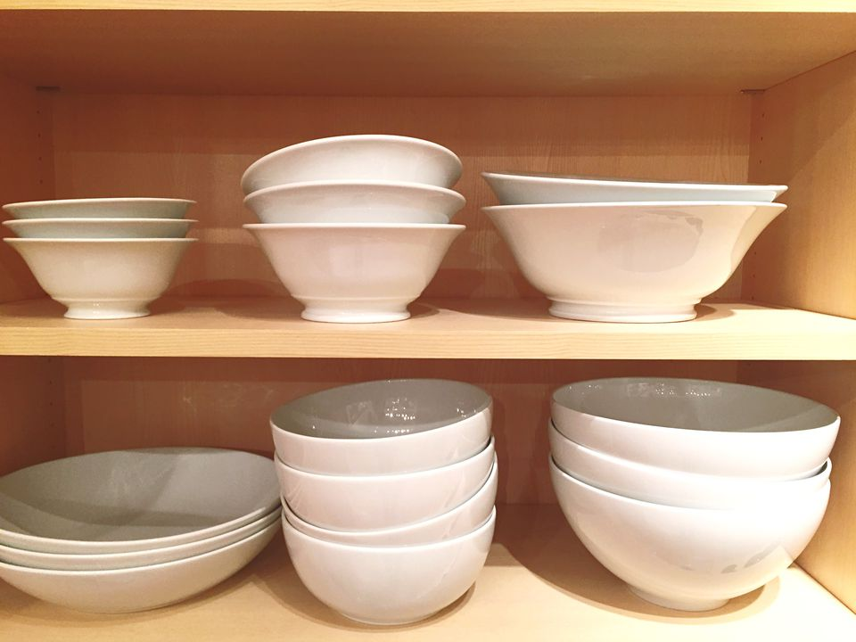 Close up of dinnerware in cabinet