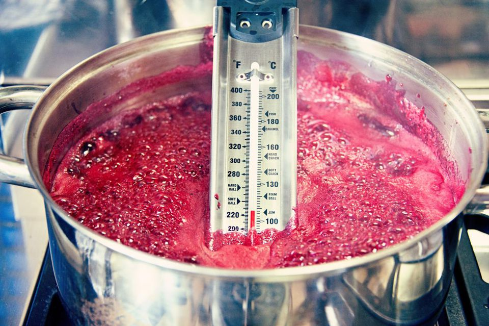Blackberry jam reaching boiling point