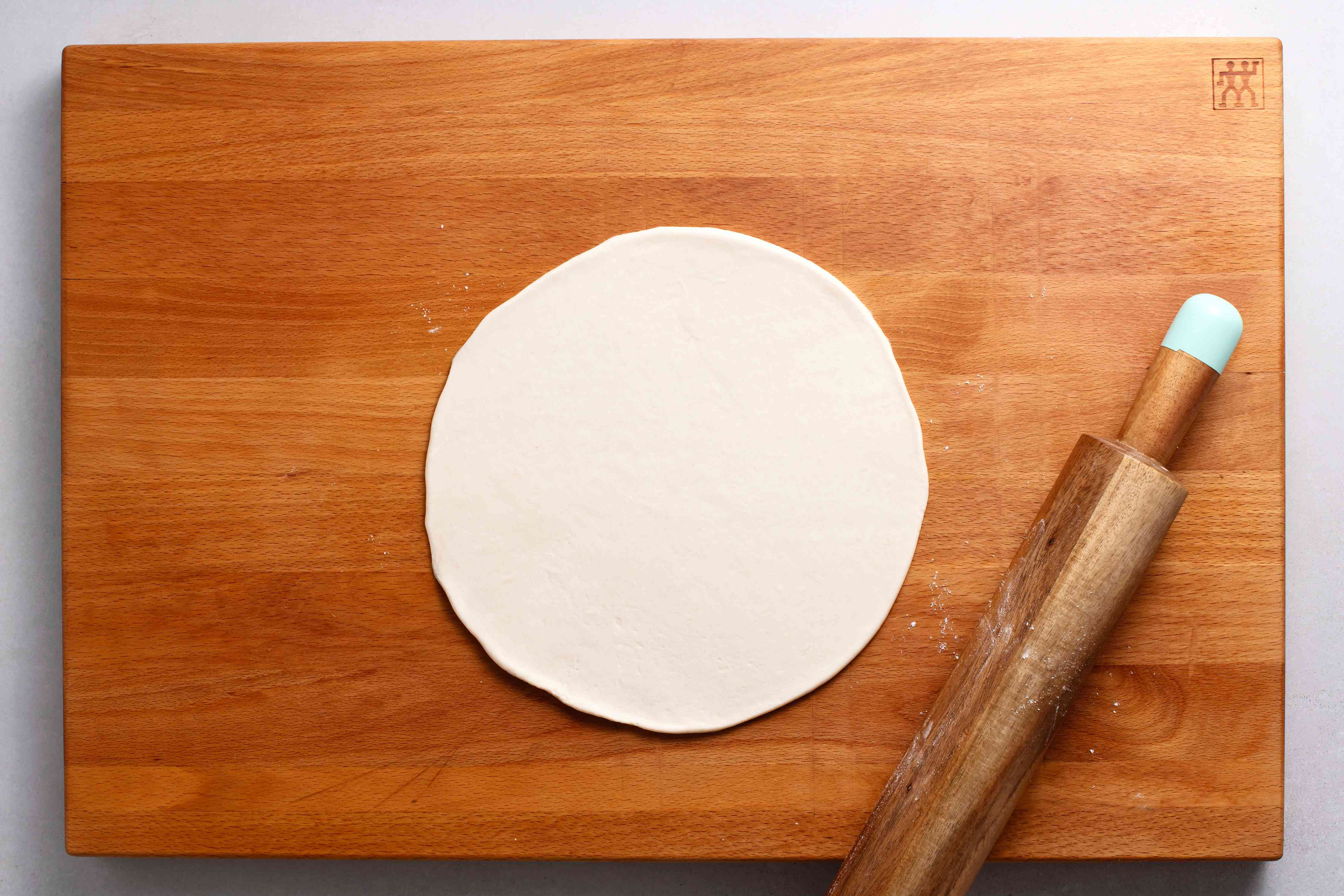 roll out dough on a wood surface