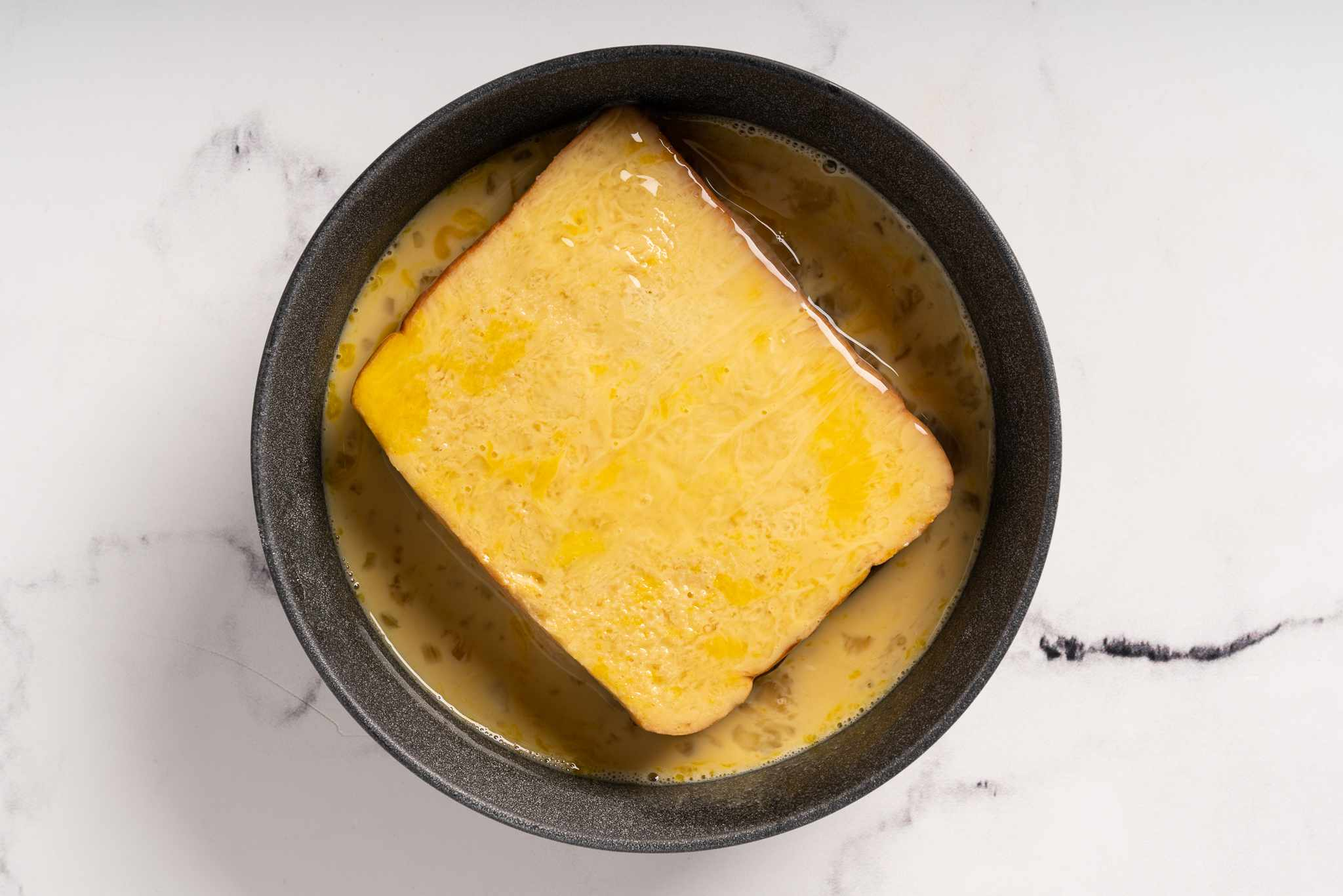 dip the bread into the egg mixture