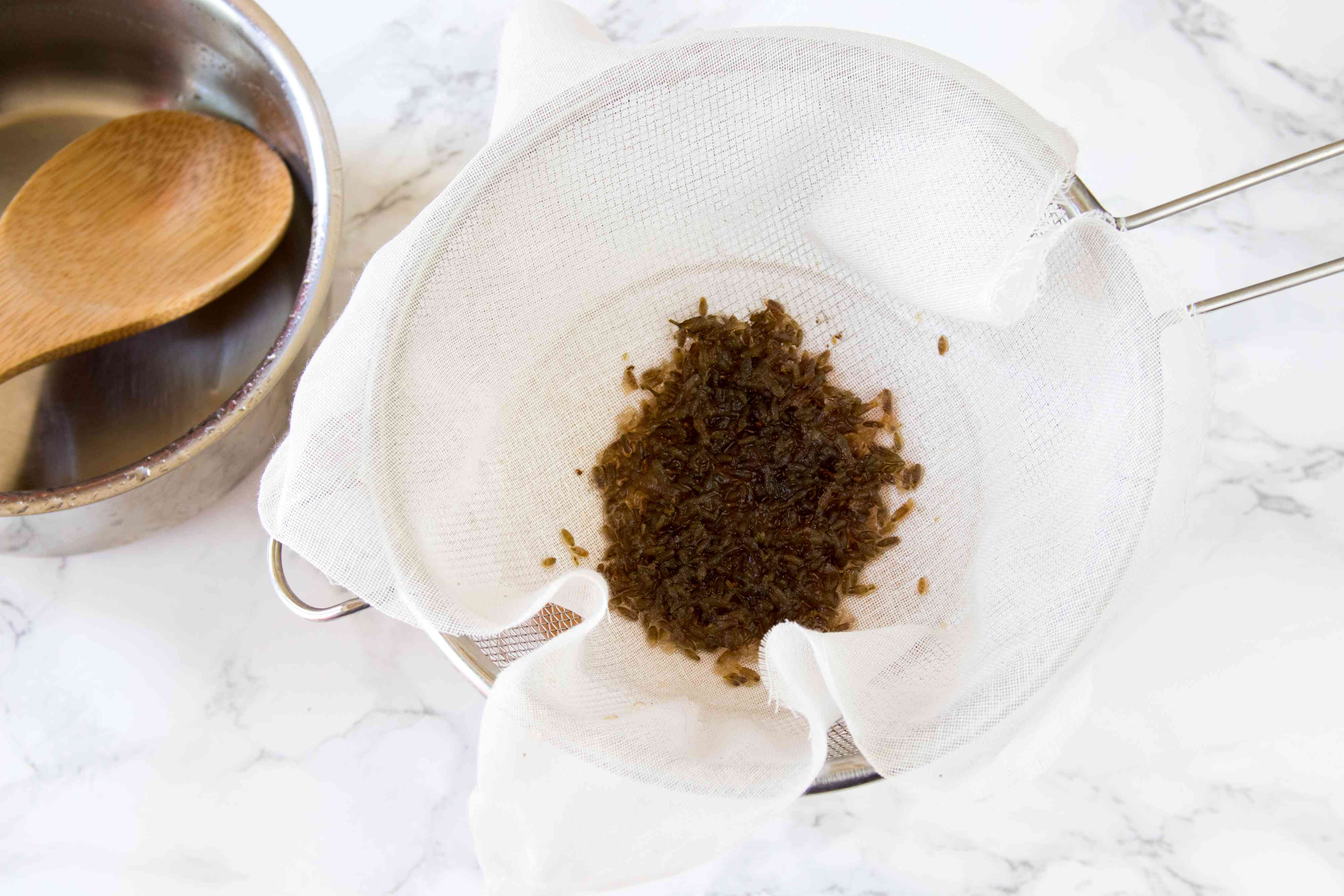 Straining Lavender Buds from Lavender Honey Syrup